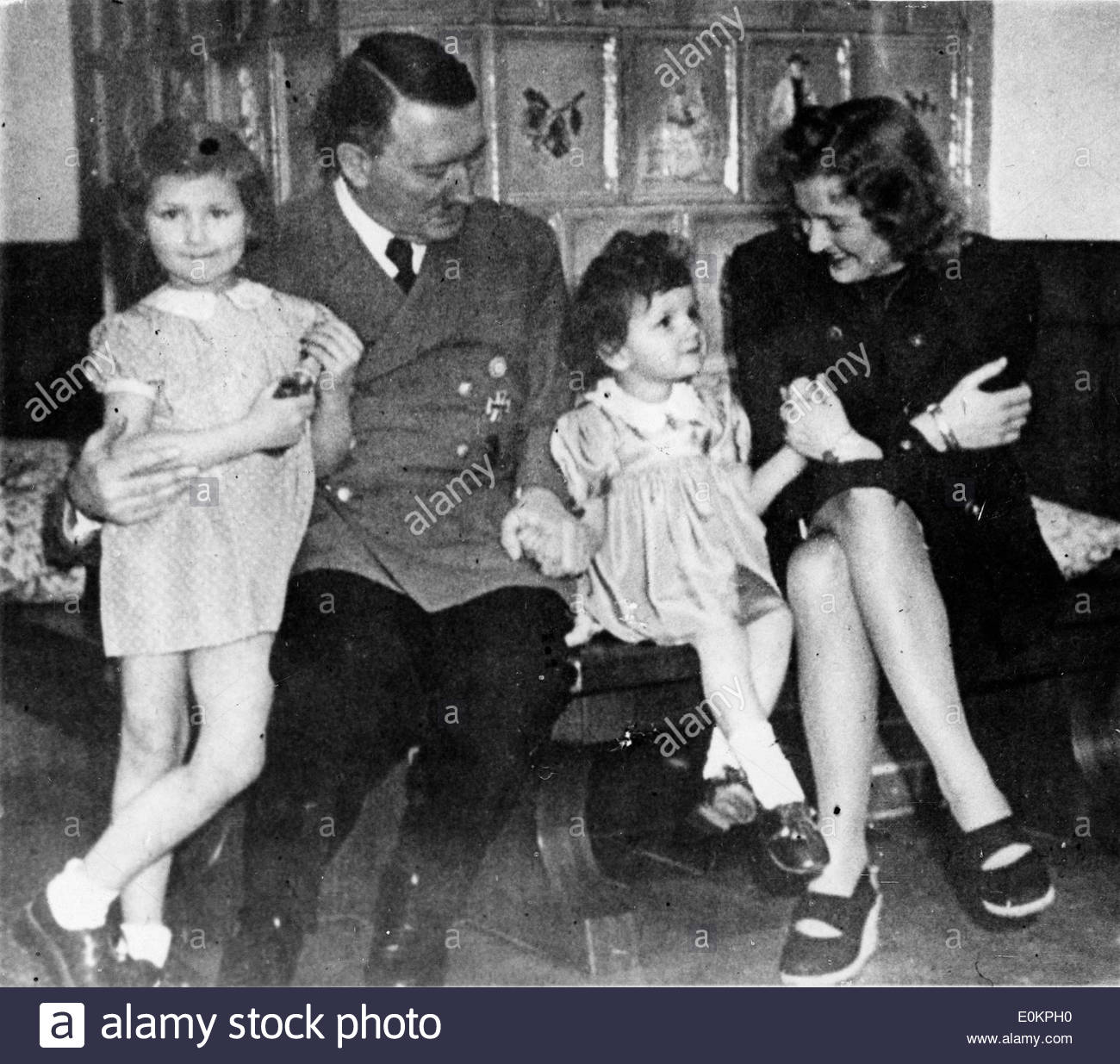 Adolf Hitler and his mistress Eva Braun visit with two ...