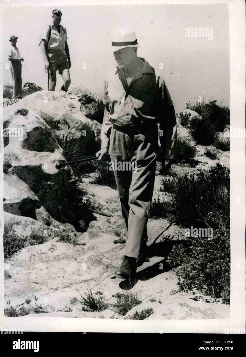 Apr. 04, 1946 - Field Marshal, the Right Hon. J.C. Smuts accompanied by Mountain climbers and a ranger, climbed over 3,000 ft. to the Summit of Table Mountain where he attended the Memorial Service to Mountaineers, a service was conducted by the Rev F.F. Komlosy, M.C., R.A.F. Photo shows after climbing over 3,000 ft. the grand old man struts along the top of the mountain towards Mclear's Beacon, the amphtheatre which he calls Cape Town Cathedral. - Stock Image