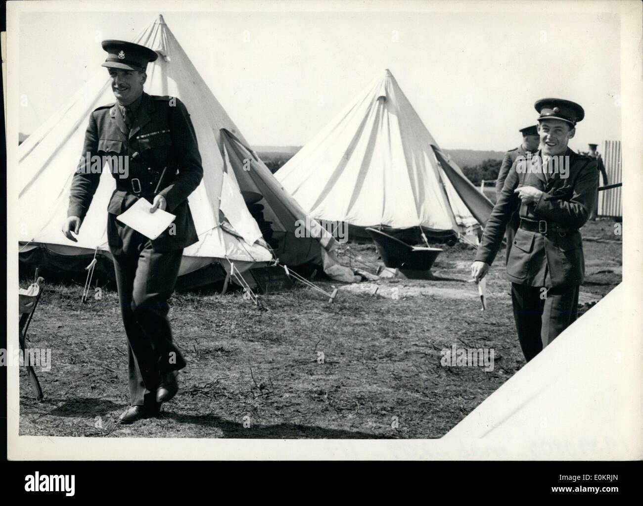 Aug. 08, 1939 - Mr. Anthony Eden in camp at Beuliukeu, Hants: Photo shows Mr.Anthony Eden photographed walking past tent at Beaulien camp, hunts, near the New Forest with the  Rangers. King's royal Rifle Corps, or which he is second-in- - Stock Image