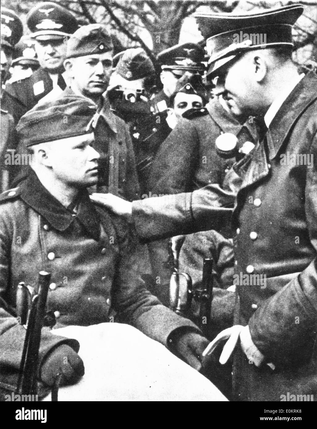Adolf Hitler talks to a wounded Nazi - Stock Image