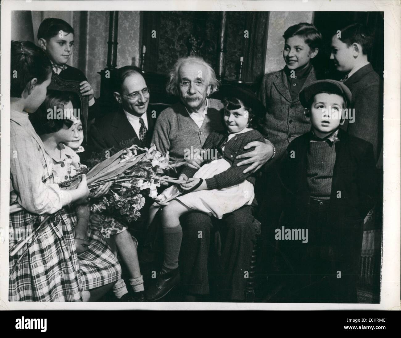 Mar. 03, 1949 - Displaced children pay per-birthday call on Albert Einstein: Youngsters from the reception shelter of united service for new American visited Dr. Albert Einstein, eminent scientist, last week at his home in princeston, new jersey. Dr. Einstein celebrated his seventieth birthday on march 14th, and as a birthdat gift a pledge was given to him by william Rossenwald that all displaced persons in European camps would be out by the end of 1949. Dr. Einstein holds 8-year-old victoria lustig on his lap - Stock Image