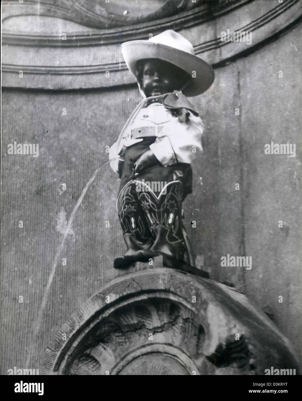 Oct. 14, 1949 - ''Manneken'' all dressed up - and Nowhere to go. Famous Brussels Statue becomes A ''Cowboy''. Photo shows ''Manneken'' the famous Brussels landmark, depicting and nnocent youth - took on a new role - when a practical joker dressed him up in cowboy clothes - but the water continued to flow. - Stock Image
