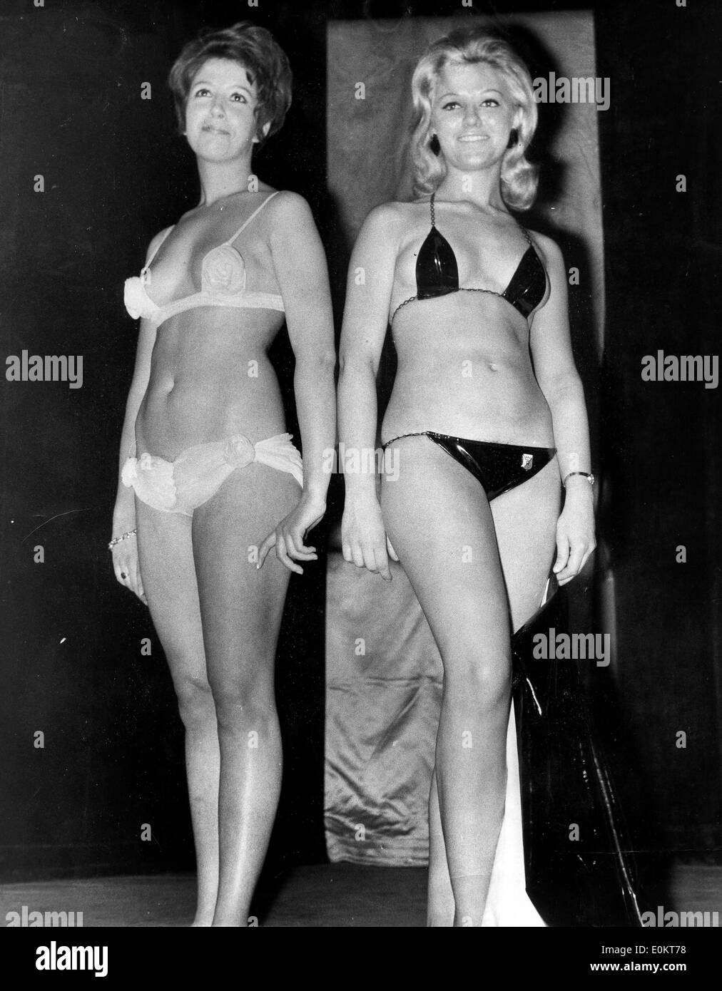 Jan. 01, 1950 - File Photo: circa 1940s-1950s, location unknown. Girls posing in bikini's in fashion shows, shoots and on beaches tanning. According to the official version, the modern bikini was invented by French engineer Louis Rekard and fashion designer Jacques Heim in Paris in 1946 and introduced on July 5 at a fashion show at Piscine Molitor in Paris. It was a string bikini with a g-string back - Stock Image