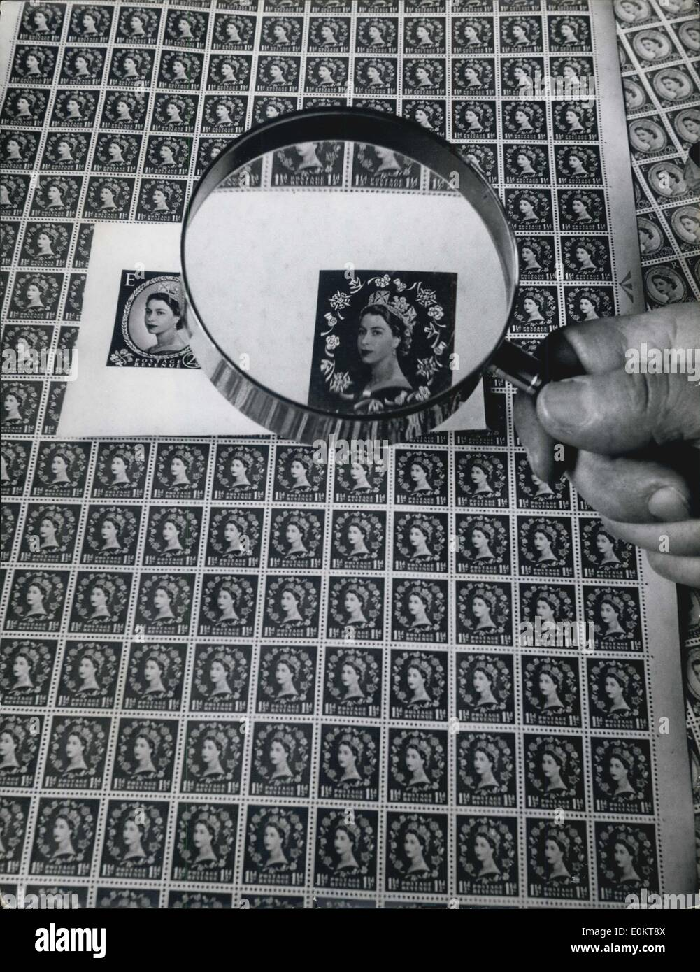 Jan 1, 1950 - Making the New postage stamps - 24 million of them: A checker uses a magnifying glass to look for rare flaws in the sheets of stamps which are being rushed through for general issue next week. They are printed at a High Wycombe factory. (exact date unknown) - Stock Image