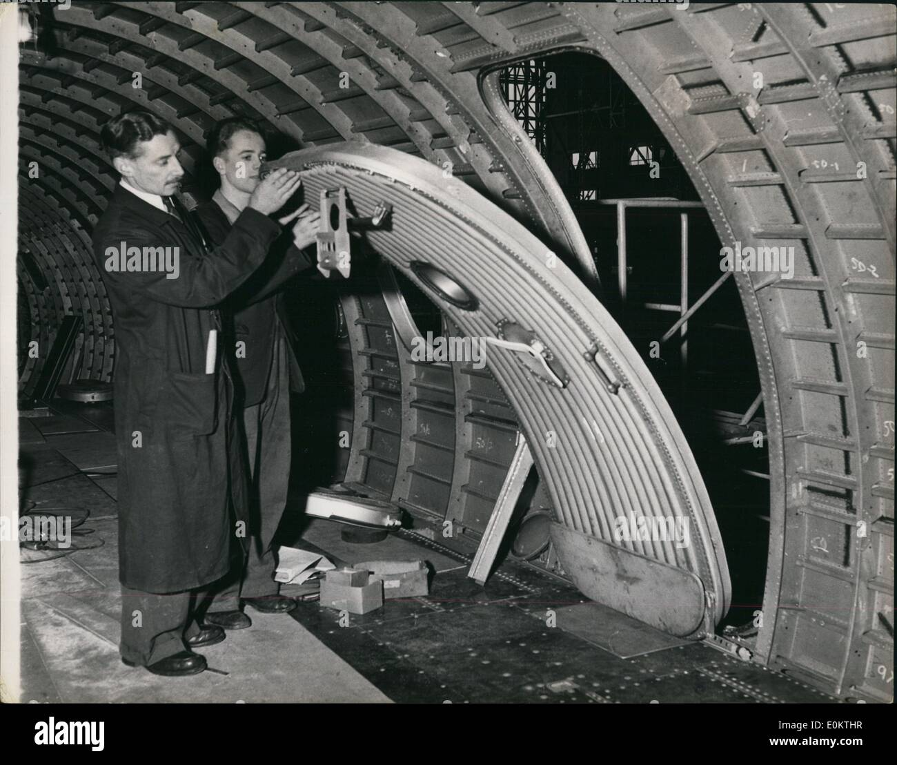 Jan 1, 1950 - Building the Britannia air liner: The huge fuselage has been built in seperate sections and is finally assembled in the Assembly hall at Bristol. This new method of assembly is in a way a form of pre - fabrication. Here a door is very light weight part plastic is being tried out before being assembled. (exact date unknown) - Stock Image