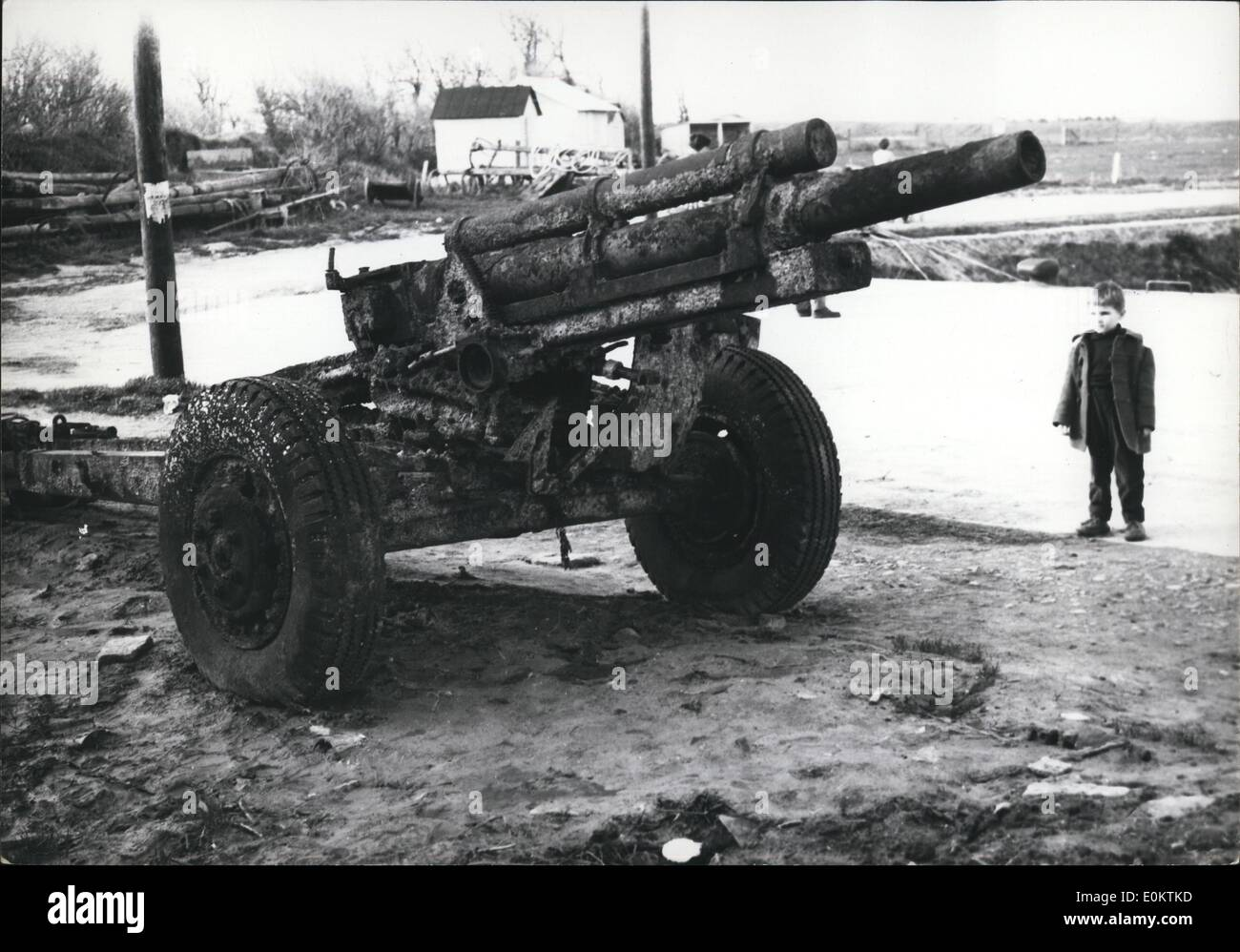 Jan 1, 1950 - A Gun On Sale: An American Field Gun Dragged Out Of The Sea By A Normandy Fisherman, Was Put On Auction Sale At Grandchamp, Normandy, Yesterday. Photo shows A Little Boy Admiring The Gun, Said The Boy: ''Pity I Am Too Small, I Should Like So Much To Be One Of The Bidders! (exact date unknown) - Stock Image