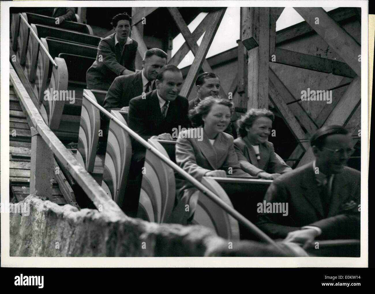 Jul. 07, 1951 - Princess Go To The Fair: Two princesses grit their teeth, smile-slightly- and hang on right as they swoop down the first steep slope of the Festival Fun Fair Big Dipper. Sitting in front of them is their father, Prince Bernhard of the Netherlands, who took the Princess, Beatrix, 13, and Irene, 11, to the Fair yesterday. It was their first visit to an amusement park and they made the most of it.They started with a 2 1/2-miinute trip on the Moon Rocket. ''Don't go too far, or too-fast, Prince Bernhard warned them as they entered the car - Stock Image