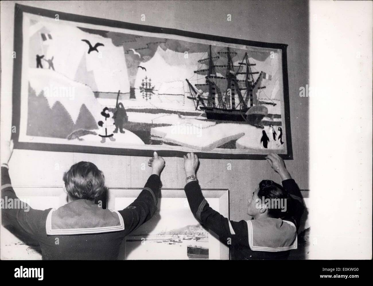 Nov. 15, 1951 - Marine show to open at Musee Galliera: Two young sailors put up a picture showing a French Polar Expedition. This picture together with many other paintings and models will be seen at the Marine Exhibition to open at Musee Galliera, Paris, tomorrow. - Stock Image