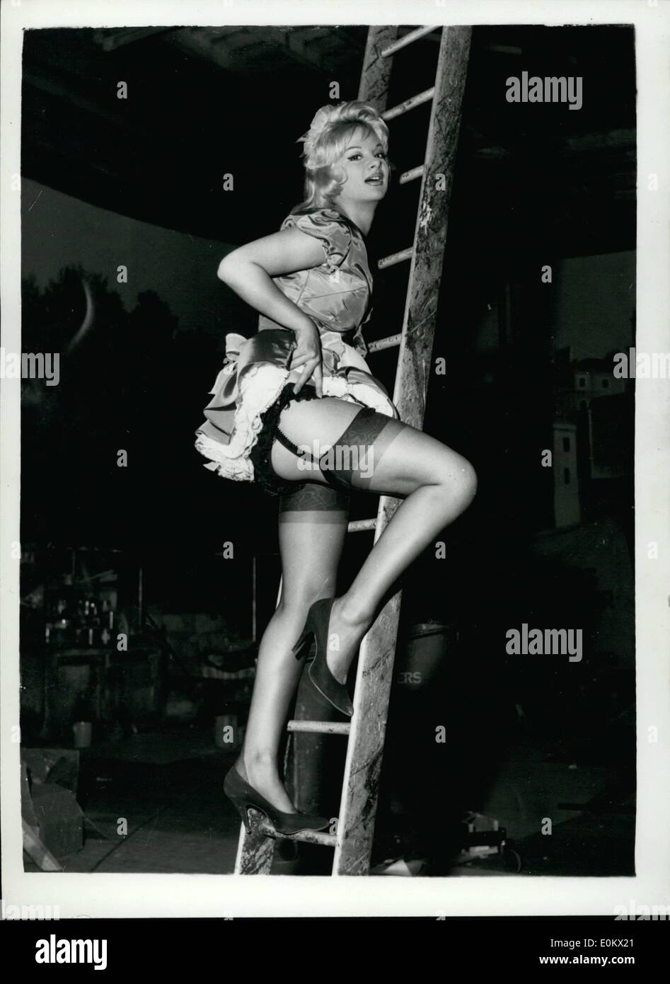 Aug. 08, 1950 - Laddered: Meet Claire Gordon, Britain's answer to Brigitte Bardot who is currently helping to make ''Beat Girl'', a film with a Soho Strip tease and rebellious youth background, at MGM's Elstree studios in Hertfordshire. The film stars David Farrar as a wealthy and successful architect (Claire is his newly hired French maid in the film), Noelle Adam (of Sagan's Broken Date ballet fame) as his second wife, and Gillian Hills, the 16 year old Bayswater schoolgirl which Roger Vadim hailed as a second Bardot (the first was his wife) - Stock Image