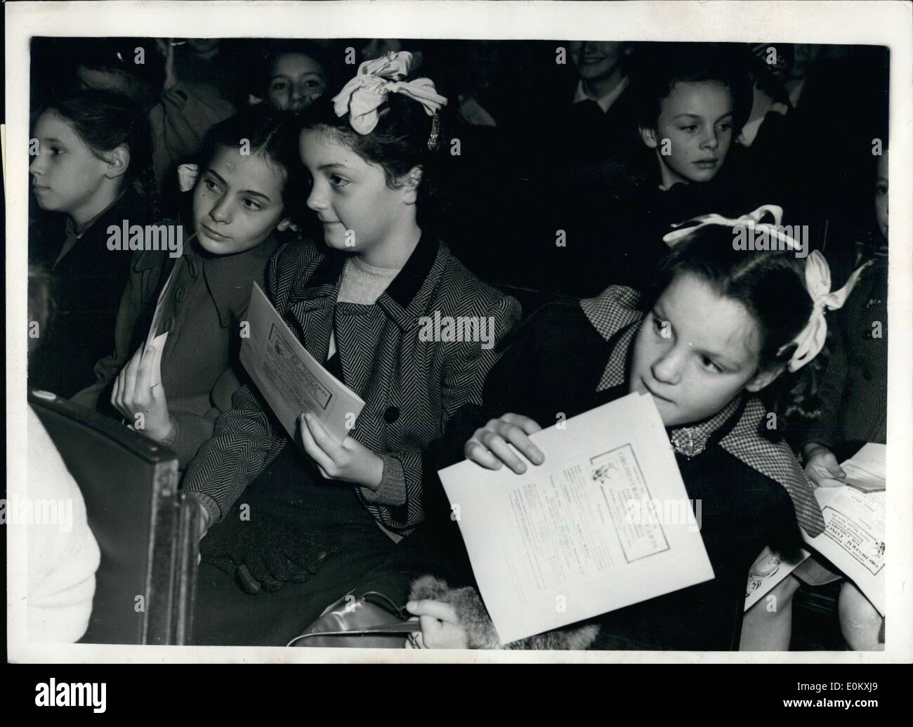 Oct. 10, 1952 - Anniversary concert : The Robert Mayer concerts for Children today celebrated their 25th. anniversary at the Central Hall, Westminster. Photo shows Robert Mayer, seen discussing the programme to ( L to R), Carol Sullivan, 9, Penelope Jolly, 9 and Margaret Huggin, 10 - all of Gough's Osk, Herts - Prior to today's concert. - Stock Image
