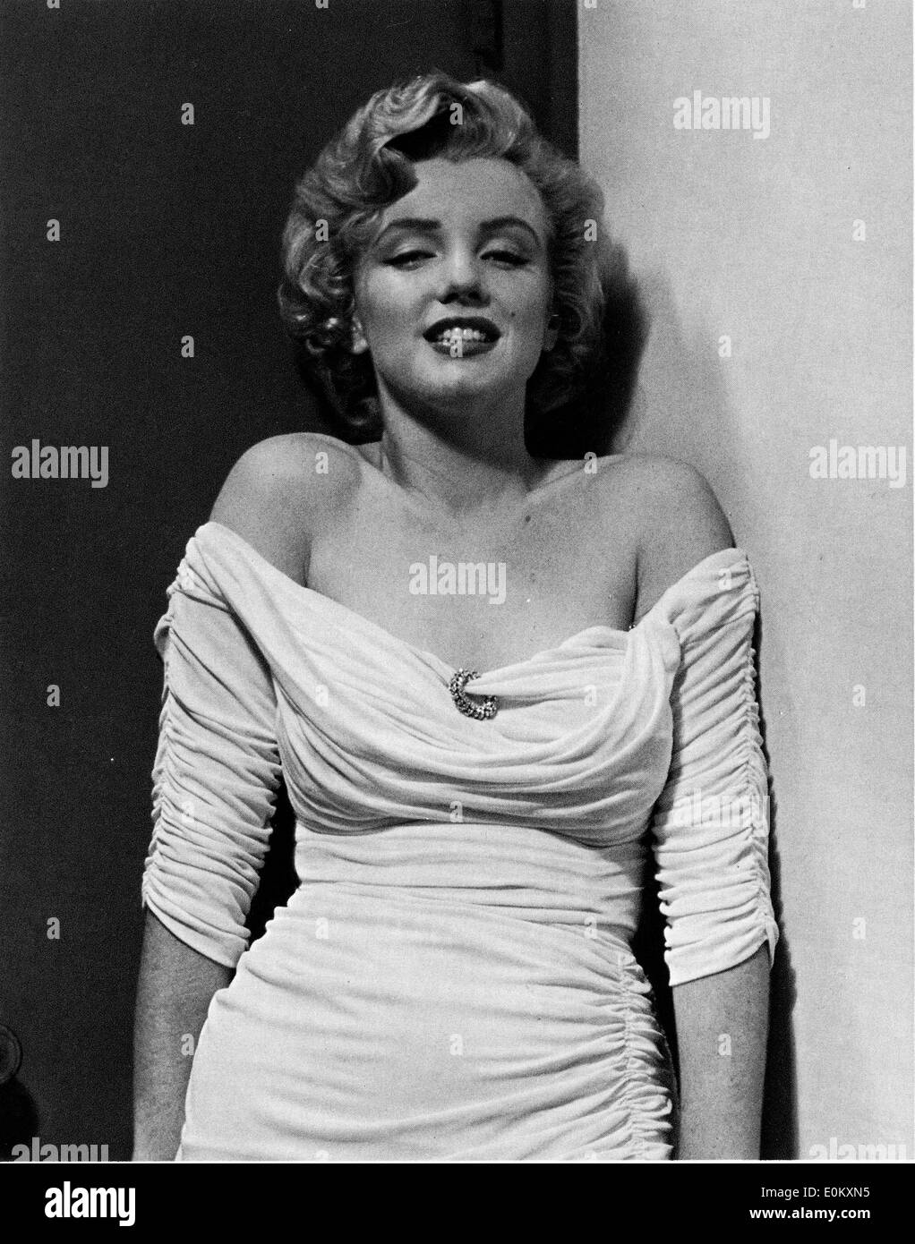 Starlet Marilyn Monroe posing for Parade magazine - Stock Image