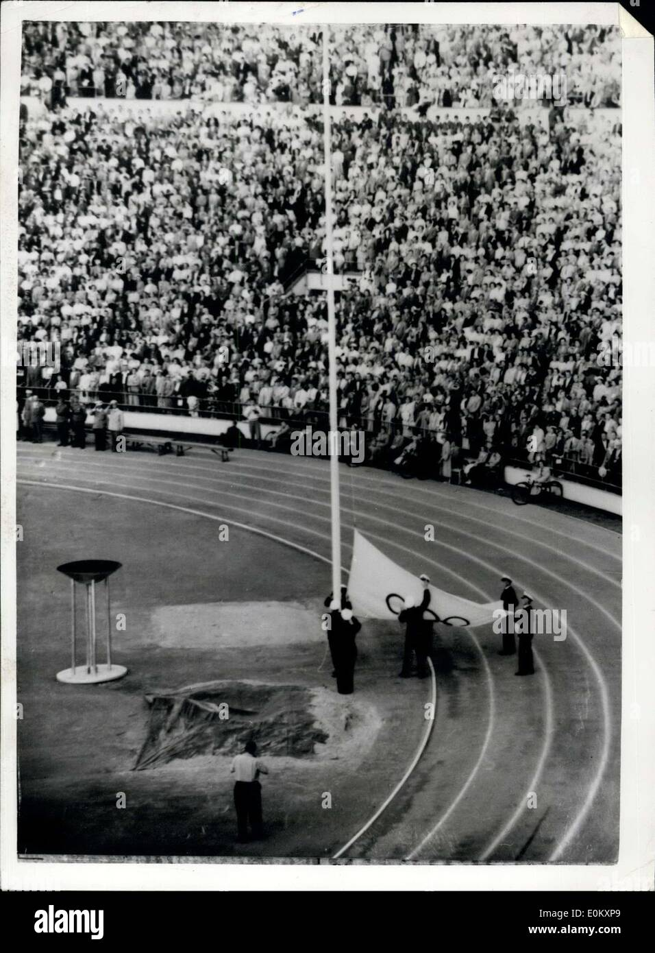 Aug. 08, 1952 - The Olympic Games end, Hauling Down the flag at Helsinki: Photo shows the scene in the Helsinki Stadium this evening as the Olympic Flag is hauled down to mark the closing of the 1952 Olympiad. - Stock Image
