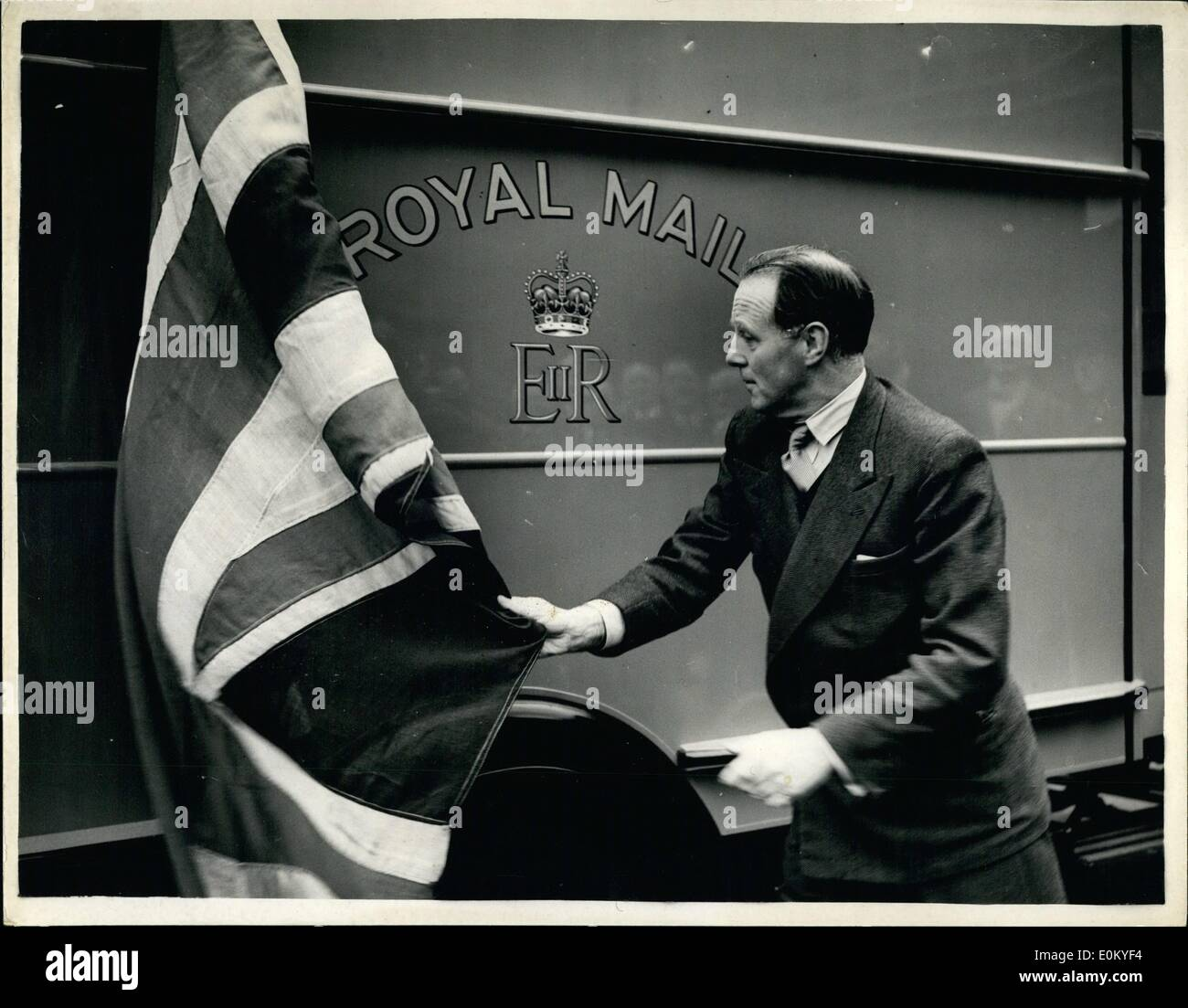 Nov. 11, 1952 - New Royal Cypher On Postal Van Unveiled By Postmaster General: The Postmaster General, Earl De La Warr, this morning unveiled the first postal van to bear the new Royal Cypher. There are about 2,200 motor mail vans in the London Area - and approximately 12,000 on the roads of the United Kingdom. In time all these vans will carry the new Cypher of Her Majesty. Photo shows Earl De La Warr seen unveiling the new Royal Cypher - in King Edward Building Yard today. - Stock Image
