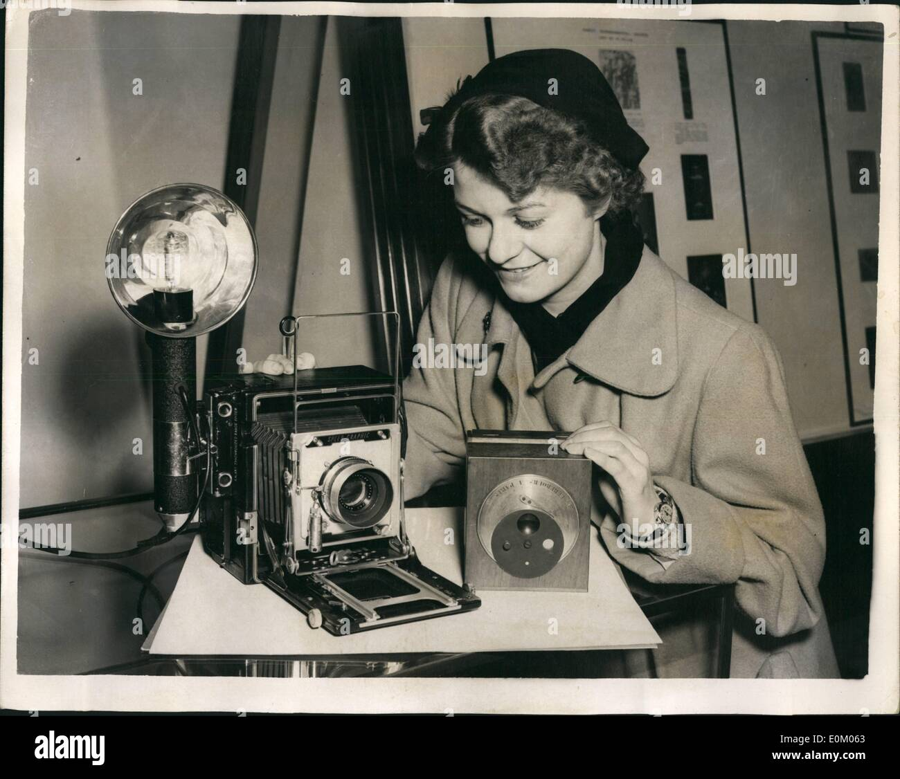 Feb. 02, 1953 - R.P.S. Centenary Exhibition in London. Ancient Andmodern: Picture shows: Miss Betty Sheppard of Leicester- makes a comparison of a Daguerreotype Camera of Fox Talbot - at the Royal Photo graphic society's Centenary Exhibition which is being held at the Science Museum, South Kensington. - Stock Image