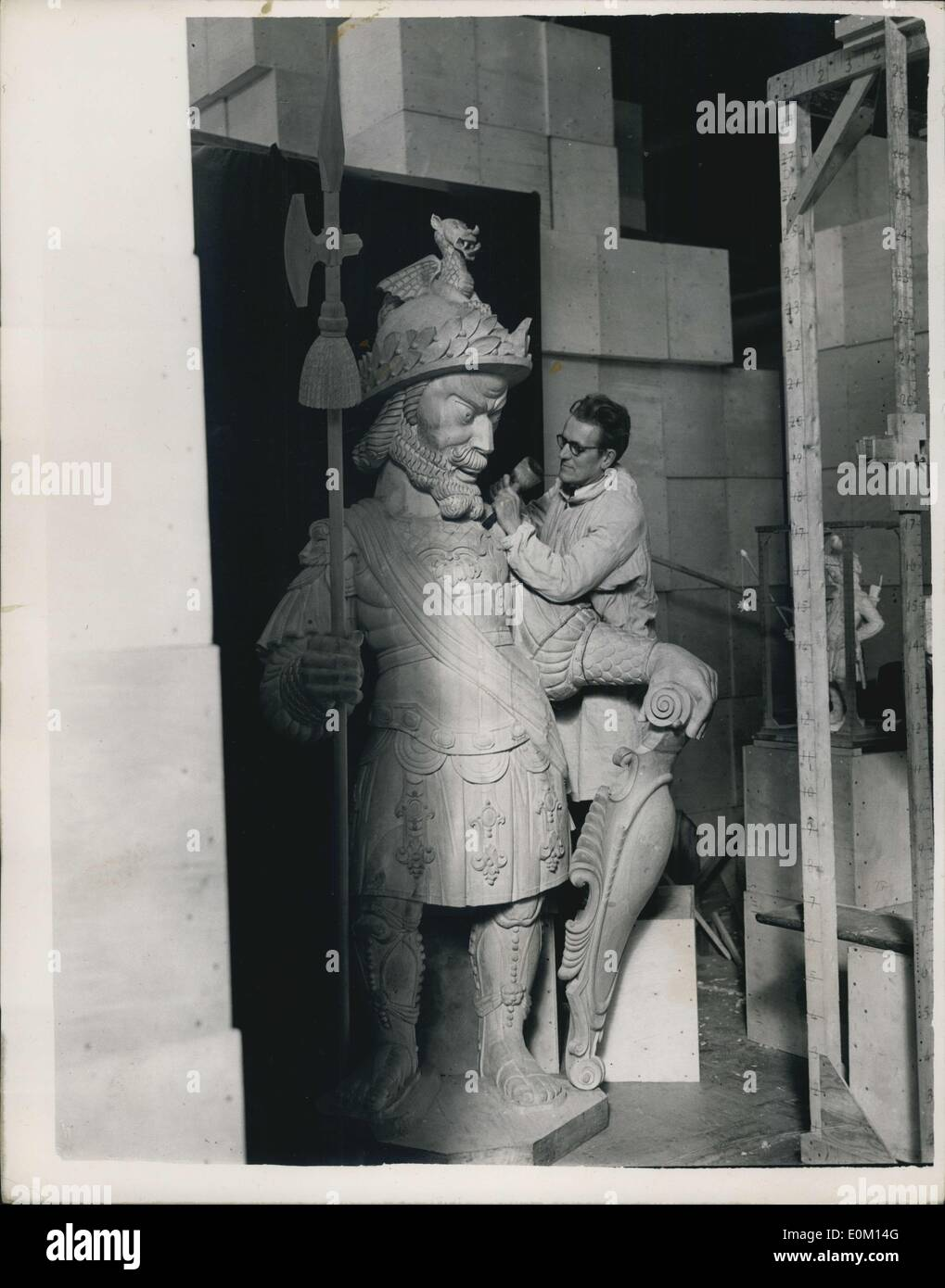 Feb. 28, 1953 - Gog and Magog Are Born Again. In a studio at Welwyn Garden City sculptor David Evans is working on two pieces of reborn London history - the new statues of those legendary giants, Gog and Magog. It is just over 12 years since their predecessors - who had stood in Guildhall since 1708 - perished in flames when fire bombs rained down. Working from clay models, the sculptor has fashioned the two statues in limewood, each 9 f. 3ins high and weighing about 15 cwt. The statues are expected to be in their places in time for the Queen's Coronation visit to the City - Stock Image