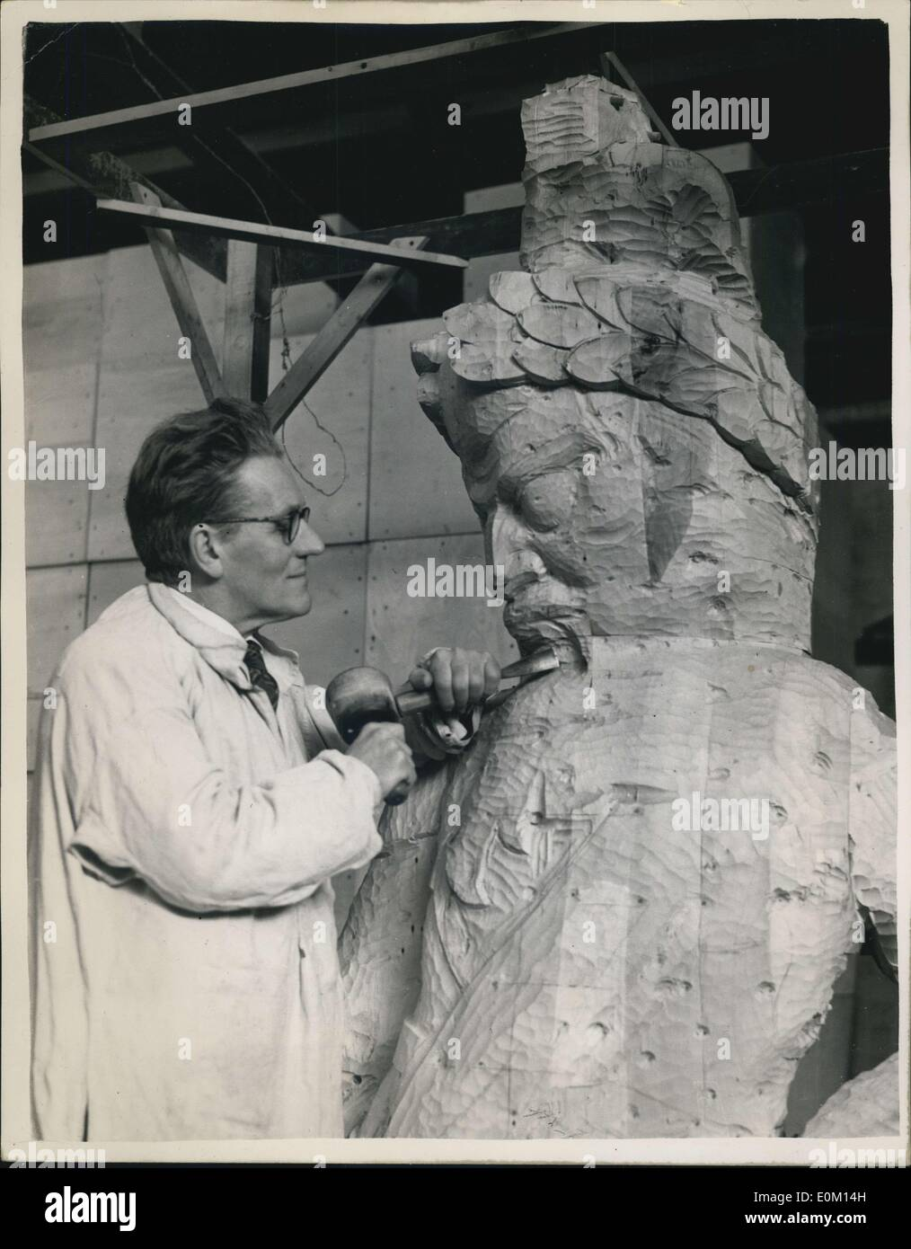Feb. 28, 1953 - Gog and Magog are born again: In a studio at Welwyn Garden City sculptor David Evans is working on two pieces of reborn London history - the new statues of those legendary giants, Gog and Magog. It is just over 12 years since their prodecessors. Who had stood in Guildhall since 1708. Perished in flames when fire bombs rained down. Working from Olay models, the culptor has fashioned the two statues in limewood, each 9ft, 3 ins high, and weighing about 15 ow. The statues are expected to be in their places in time for the Queen's Coronation visit to the city - Stock Image