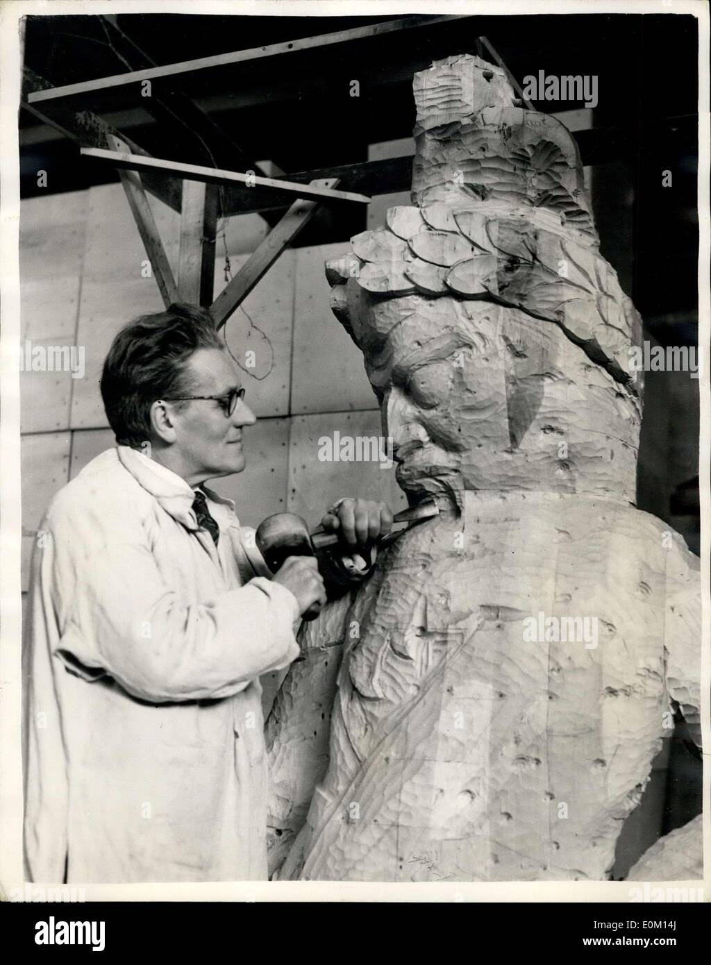 Feb. 28, 1953 - Gog and Magog are Born again: In a studio at Welwyn Garden City sculptor David Evans is working on two pieces of reborn London history - the new statue of those legendary giants, Gog and Magog. It is just over 12 years since their predecessors - who had stood in Guildhall since 1708 - perished in flames when fire bombs rained down. Working from clay models, the culptor has fashioned the two statues in limewood, each 9ft.3 ins.high, and weighing about 15 owt. The statues are expected to be in their places in time for the Queen's coronation visit to the City - Stock Image