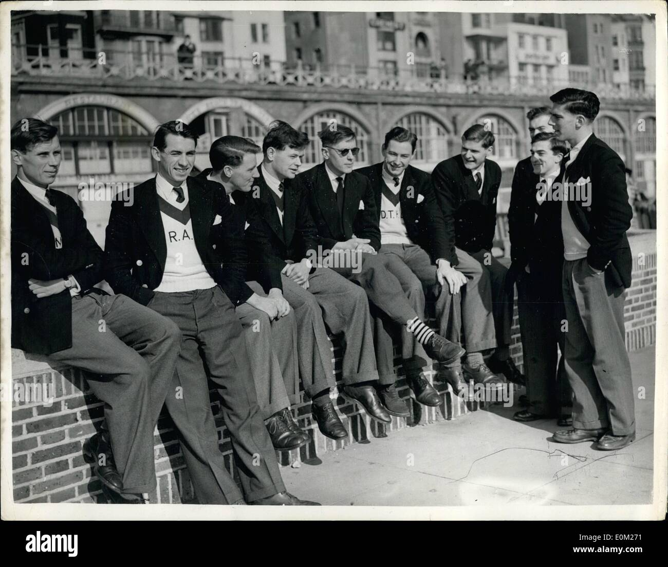 Mar. 03, 1953 - Oxford Boat Race Crew Relax At Brighton: Members of the Oxford boat-race crew, seen as they relax at Brighton yesterday. (L to R): H. Quick, R. Byatt, J. Howles, M.L. Thomas, E.B. Hammond, D.T.H. Davenport (hidden), J.M. Wilson (standing), W.R. Marsh, cox, J. Sobbo and A.J. Smith. - Stock Image