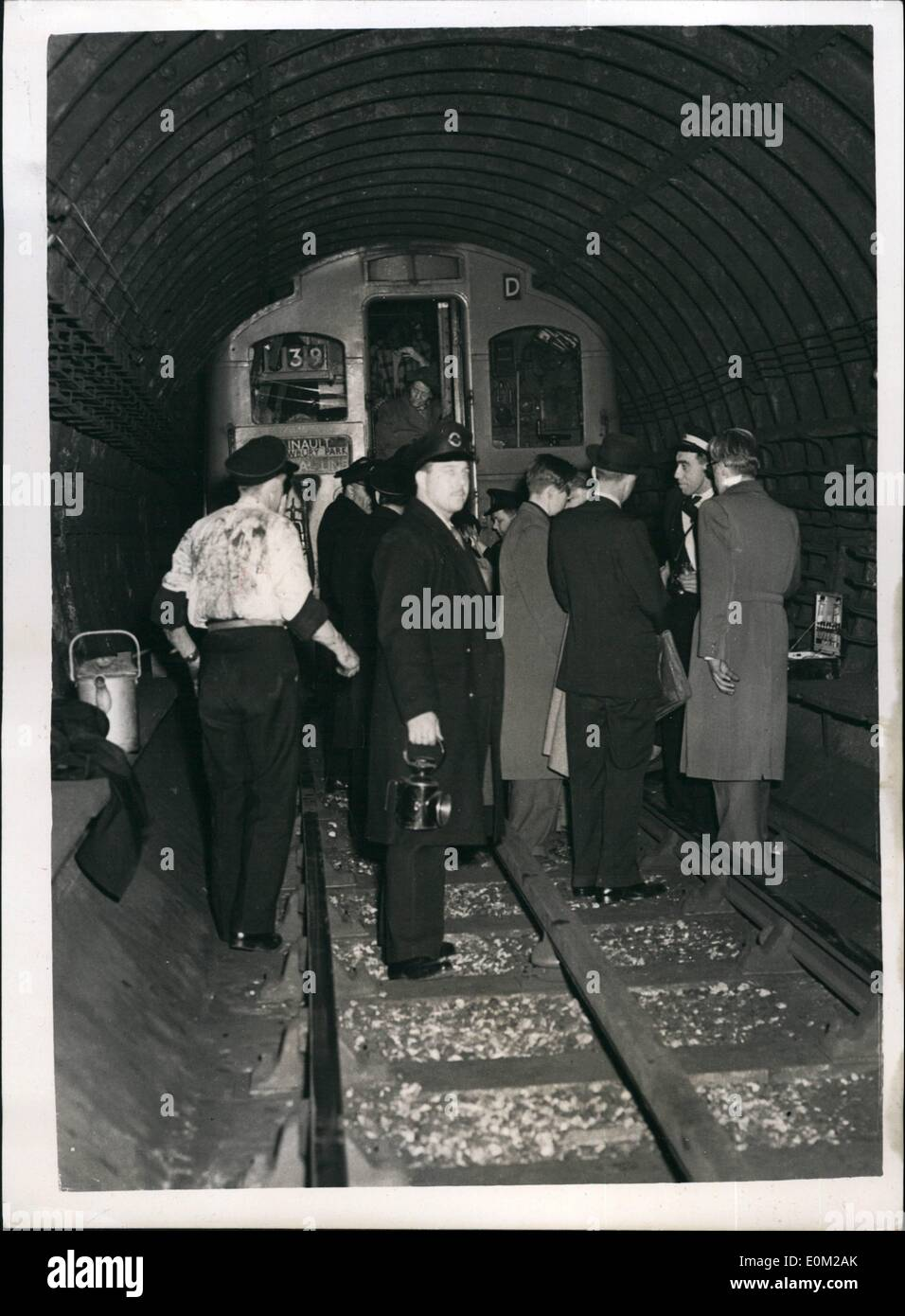 Apr. 04, 1953 - NINE DEAD IN TUBE DISASTER. Nine people were known today to have died in the General Line tube disaster at Stratford last night - the worst in London's Underground history. It was the second coach of the Esling Broadway-Epping train which took the brunt of the crash. The train ran into the rear of the another train travelling from Greenford to Heinault. Keystone Photo Shows:- Last night's scene as railway officials help passengers from the rear of one of the coaches after the crash at Stratford - Stock Image