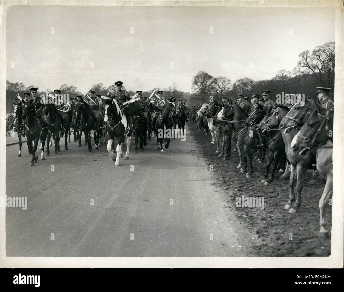 Apr. 04, 1953 - Band of the Household Cavalry Help in training Horses for V.I.Ps' - during the coronation.: The Band of the Household Cavalry ( The blues) playing as they pass horses which are being trainess at a special Camp in Hyde Park - by Army and R.A.F. Volunteers . The horses are being acoustomed to many V.I.P's who will take part in the Coronation procession. - Stock Image