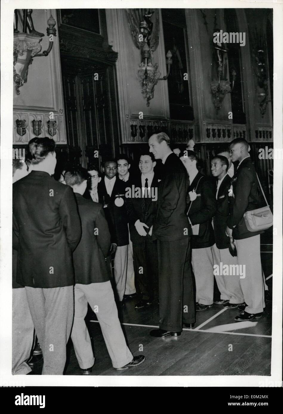 Apr. 07, 1953 - 7-4-53 American boy boxers meet the Duke of Edinburgh. Visit to Windsor Castle. A party of boy boxers from New York who are to meet Boys of the London Federation of Boys Clubs at the Empress hall on Wednesday were taken on a tour of Windsor Castle by H.R.H. The Duke of Edinburgh today. Keystone Photo Shows: The Duke of Edinburgh chats to the New York Boy Boxers at the famous St. George's Hall, Windsor Castle. - Stock Image