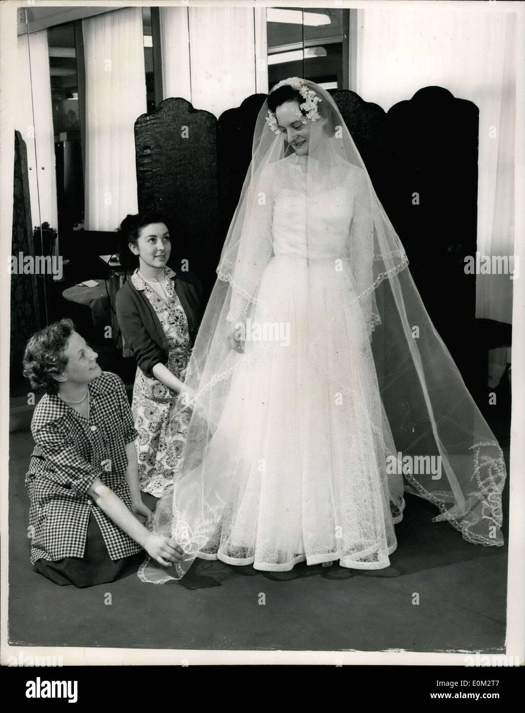 May 13, 1953 - ''Bose'' Presents  With Her Wedding Gown Dig By Morton Employer To Marru: Then twenty-two years old seamstress Joan Merton is married to Sidney Ohrles Watts of Tilse Hill, on Saturday - she will be wearing a glamorous wedding gown of Nottingham Lace over the White Satin with Coronation design at the Neck, embroidered with emblem and races....Joan is employed as a seamstress at the work comes of Digby Morton -- the London designer and for a wedding present Digby Morton has presented her with wedding gown - Stock Image