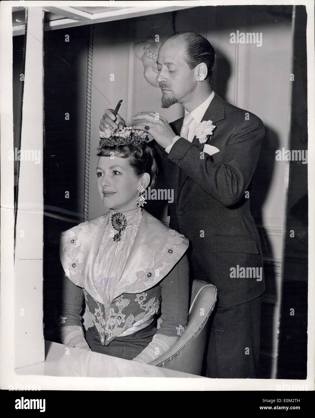 May 14, 1953 - The Hon. Mrs. Gerald Legge has a special hair-do 19th. Germany for Charity Show: The Hon. Mrs. Gerald Legge who is playing the part of a coquette in a special production of ''Lord and Lady Algy'' - paid a visit to the West End Hair Stylist Steiner to receive a special 19th. century hair-o. The show is to be produced aid the Children's Aid Association. Other members of the cast include Mrs. Ghislaine Alexander; Lord Porchester; Lord Ednam and Billie Wallace. Photo Shows Mrs. Gerald Legge having her hair dressed - 19th. century style - by Steiner. - Stock Image