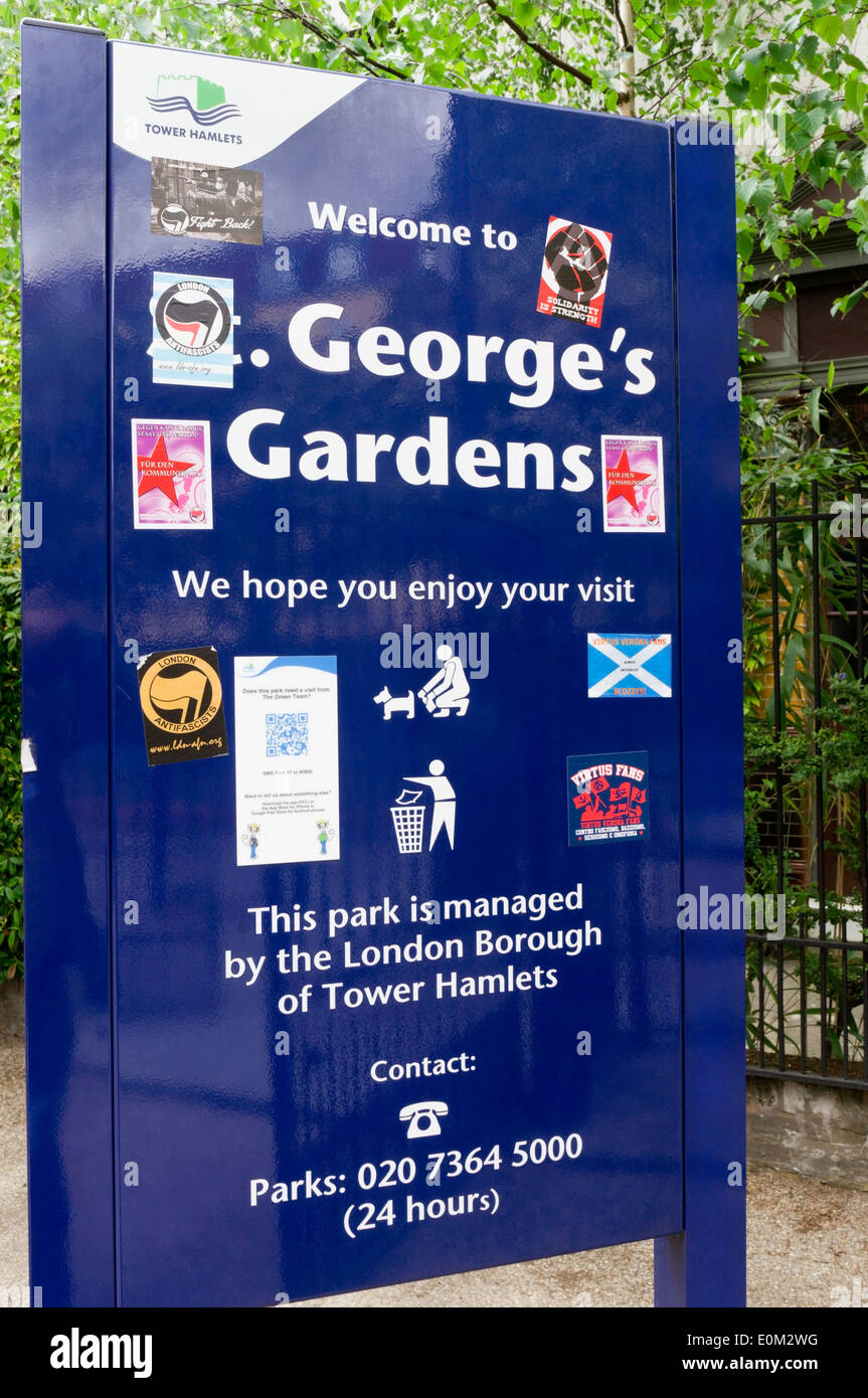 Sign for St George's Gardens in East London, covered in anti-fascist stickers. Park is next to the Battle of Cable Street mural. - Stock Image