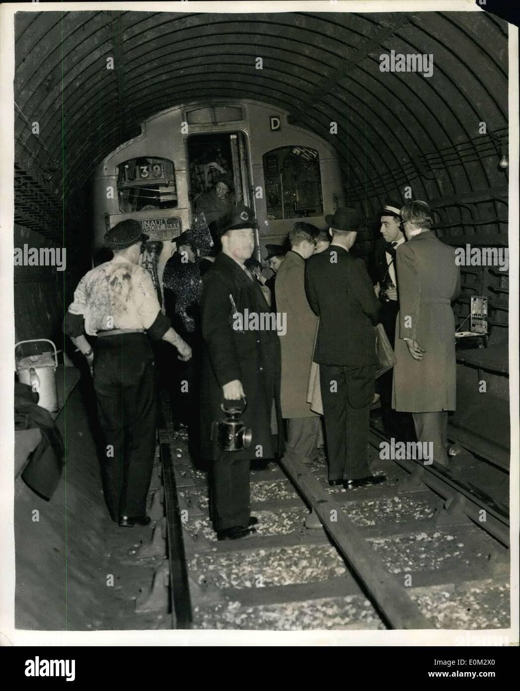 Apr. 09, 1953 - Nine Dead in Tube Disaster - Nine People Were Known Today to Have Died in the Central Line tube disaster at Stret ford last night - the Worst in London's Underground history. It was the second coach of the Esling Broadway-Epping tain which took the brunt of the crash. The Train ten into the rear of another train travelling from Greenford to Hainaule. keystone Photo Shows:- Last Night's Scene as Railway officials help passengers from the rear of one of the coaches after the crash at Stree ford - Stock Image