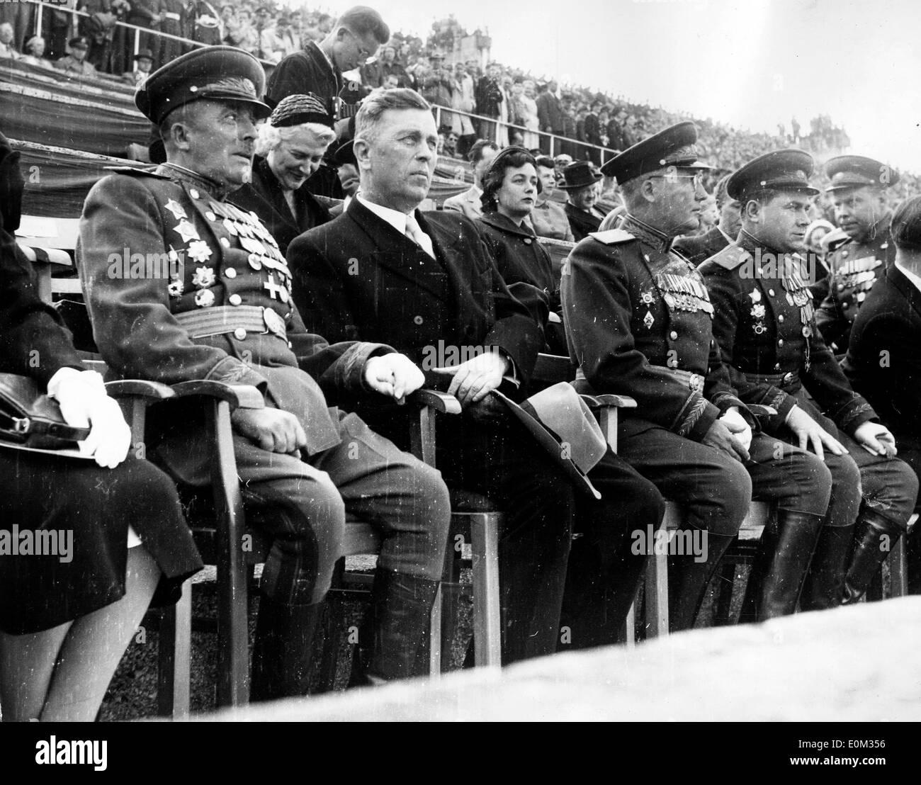 Nikolai Trusov and Sergei Dengin watch the Coronation Day Parade - Stock Image