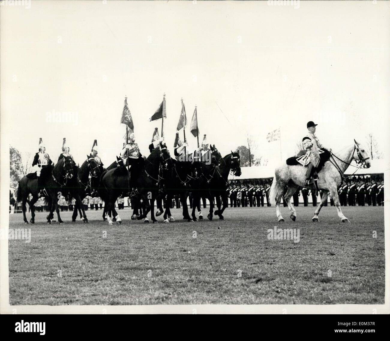 Apr. 28, 1953 - Queen presents new colours to Household Cavalry. Handing over at Home Park, Windsor ? H.M. The Queen this morning presented new colours the two regiments of the Household Cavalry, the Life Guards (The Reds) and the Horse Guards (The Blues) in a ceremony at Home Park, Windsor. Keystone Photo Shows: Carrying their new colours, men of ?The Blues parade past after the ceremony at Home Park, Windsor, today. JSS/Keystone - Stock Image