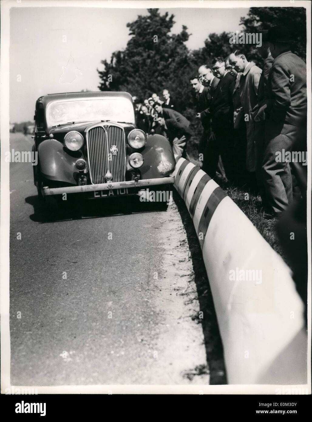 Jun. 06, 1953 - Demonstrating The Dahl Safety Kerb New Road Device For Saving Life.. A demonstration was held this afternoon along a stretch of road two miles South of Bletchloy, beside the Grand Union Canal - of the ''Dahl Safety Kerb'' - which consists of white reinforce concrete section supported that on impact by a nearside front tyre the course of the vehicle is deflected along the direction of the ''Kerb'' producing a braking effect which onables the driver to regain control - Stock Image
