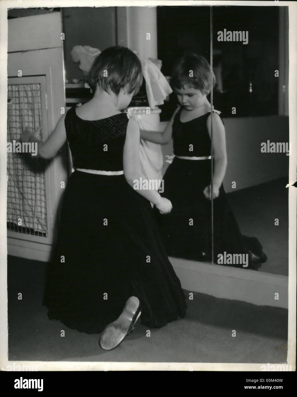 May 05, 1953 - How To Curtsy - By Portland Mason: You put one foot back and you bend a knee. Now you sink gracefully - and that, as 4-year old Portland Mason is fast finding out, is the tricky bit. Portland, daughter of film star James Mason, tried out her curtsy yesterday wearing her new black Digby Morton gown. - Stock Image
