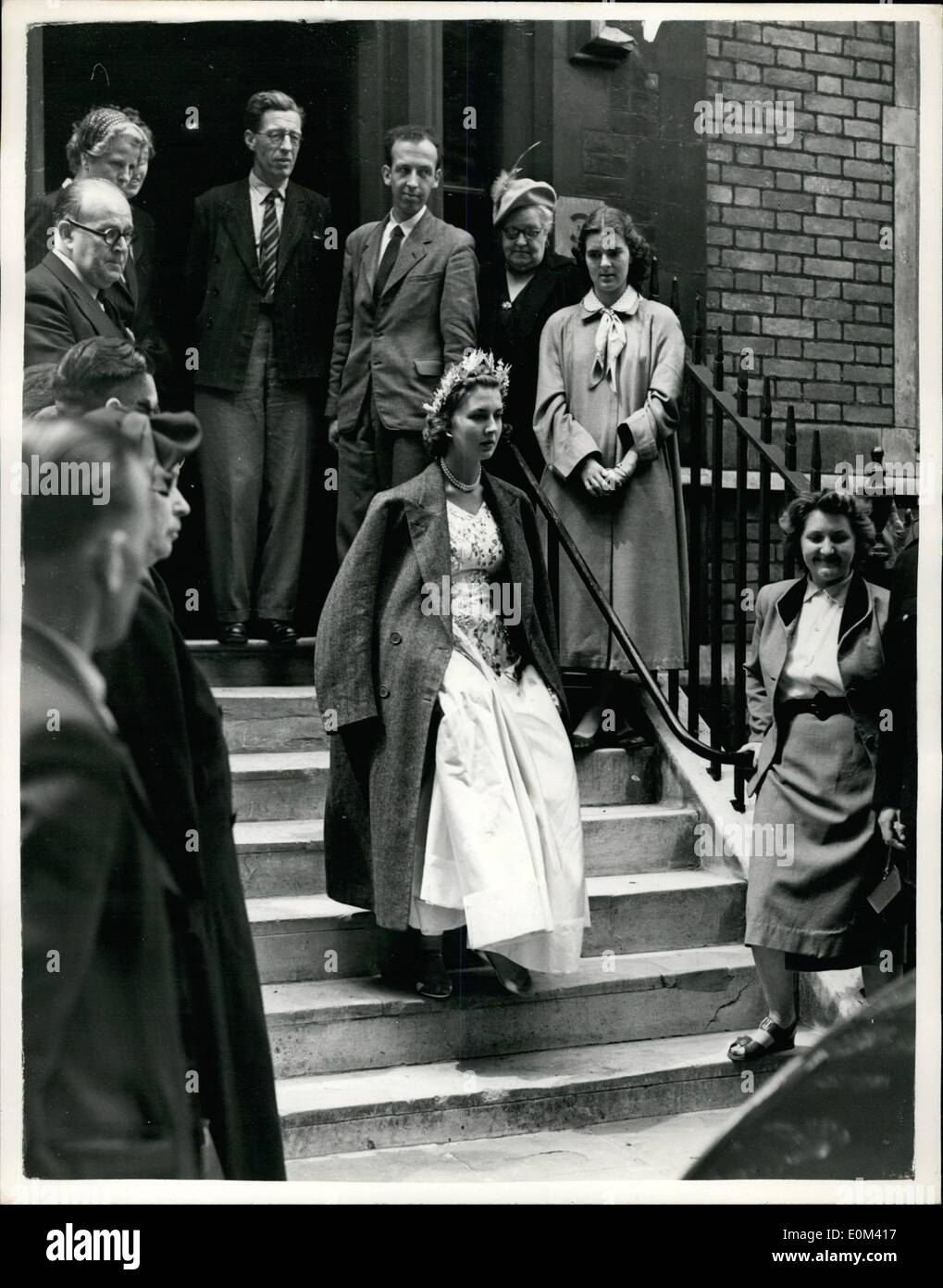 May 05, 1953 - Full Coronation rehearsal... Lady Jane Tempest-Stewart uses a coat to keep warm: Photo shows Lady Jane Vane-Tempest-Stewart one of the Maids of Honour - wears an overcoat over her shoulders - when in Dean's Yard, Westminster this morning - after taking part in the full rehearsal for the Coronation. - Stock Image