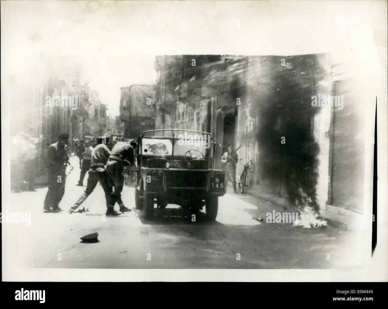 May 05, 1953 - Bombs thrown in Cyprus.: A British soldier was killed by a bomb in Nicosia today, as troops fought to disperse schoolgirl demonstrators. Two Greek Cypriots were injured when one of the bombs was thrown at an Army patrol car.A police officer was also injured. Photo shows the scene in Ledra Street, Nicosia today, showing an Army patrol car on fire - as a result of a bomb thrown by demonstrators. - Stock Image