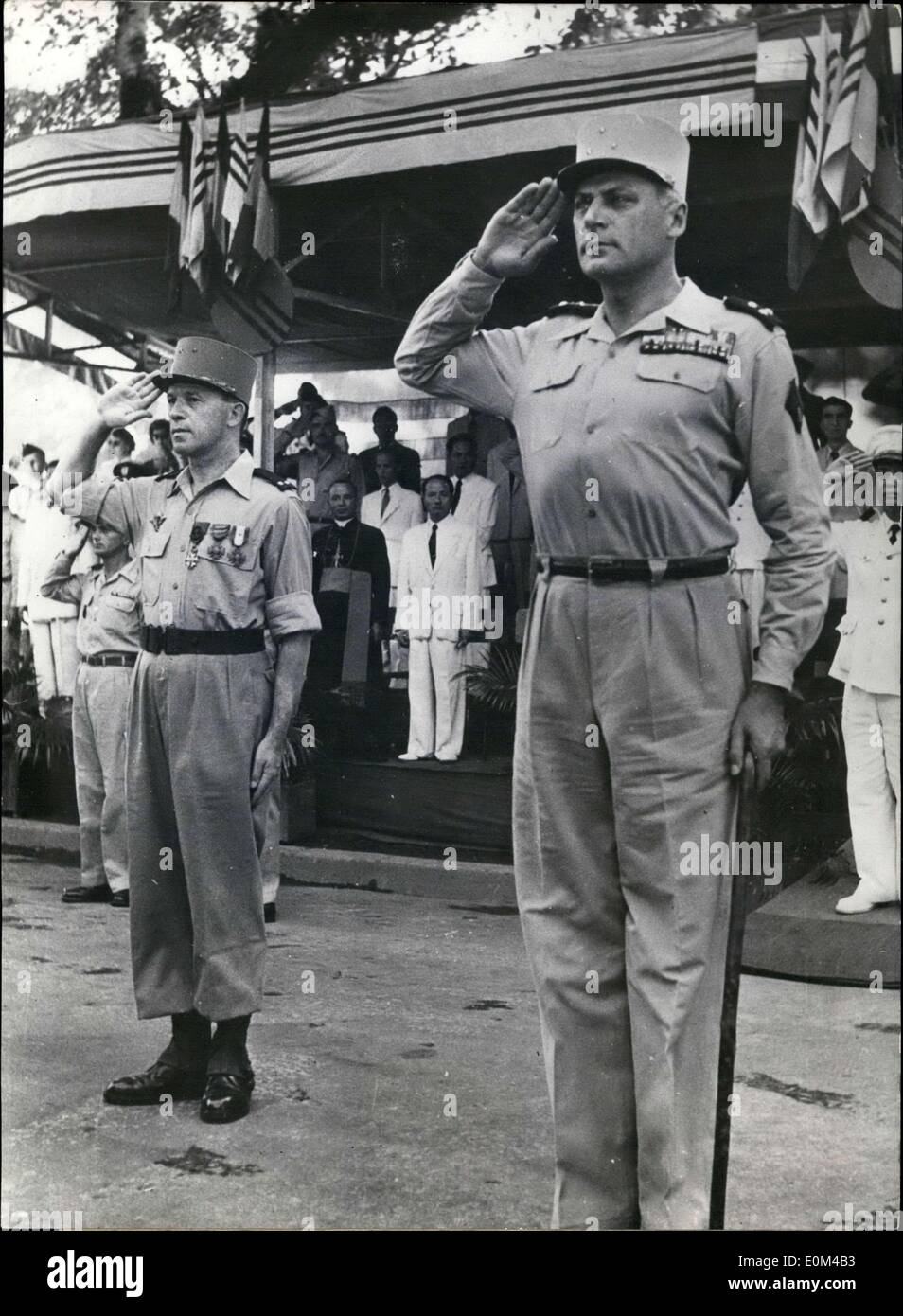 Jul. 24, 1953 - Bastille Day was celebrated in Hanoi by ceremonies on a major scale. General Cogny, commanding the TTNV, salutes the flags. General Masson is to his right. - Stock Image