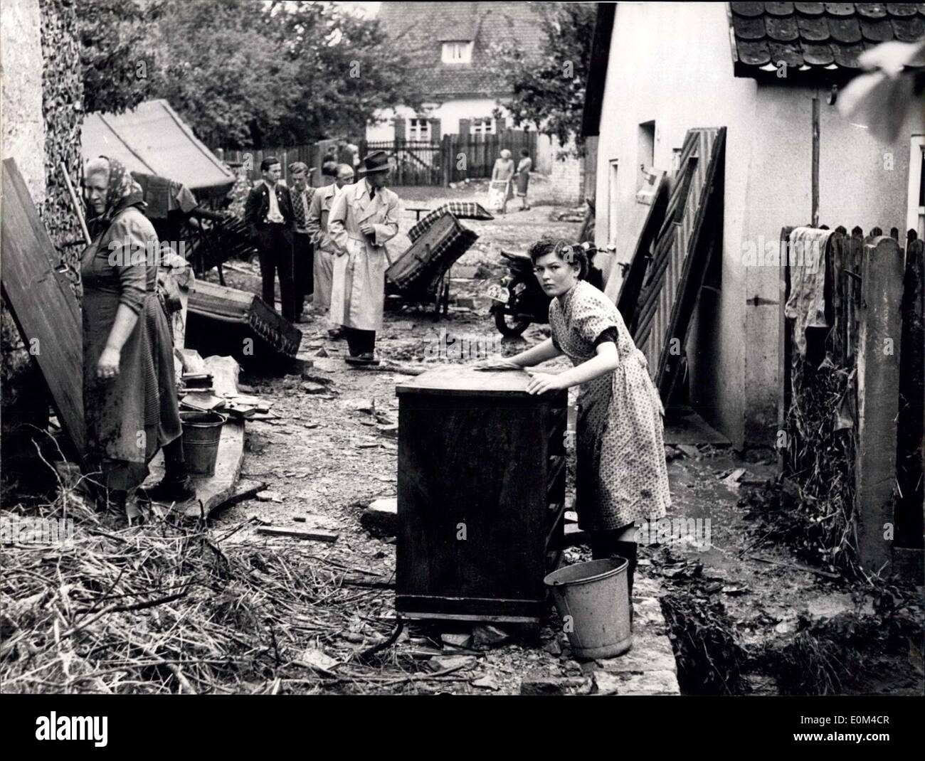 Jun. 15, 1953 - Floods in Lower Bavaria, - Greding afflicted by storms and cloud-bursts. - Fifty families lost home and property. During the weekend, the village of Greding, near Nuremberg Southern Germany, was afflicted by heavy storms and cloud-bursts. the Muehl-rill, in summer usually a dead watercourse, all over a sudden turned to a 200 meters wide raging river and carried away stables, sheds, household-furniture ad thousands of hundred-weights of grain - Stock Image