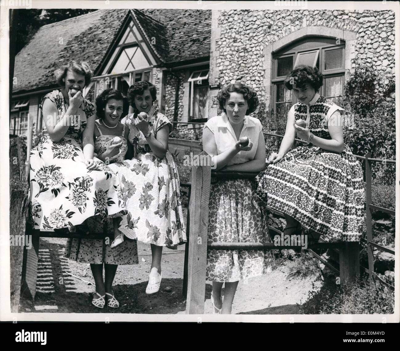 Jul. 07, 1953 - Village of Beautiful Girls- Girls Outnumber men by Four to one: Bramber with a population of 400 is decreed in guide books as one of the most picturesque villages in Sussex. But it isn't one of the most romantic. The reason for that is because there is only one eligible bachelor for every four of its glamorous girls. Mrs. Peggy Glenie, manageress of the Castle Hotel said, ''The shortage of men is terrible''. Every evening groups of two or three girls go into Mrs. Glenie's her just to pass away the time - Stock Image