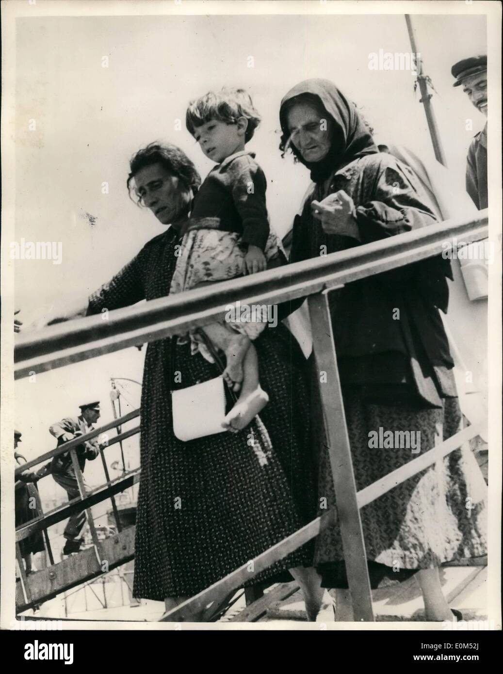 Aug. 08, 1953 - THE GREEK EARTHQUAKE DISASTER WHOLE TOWN SLIDE INTO SEA.; More tremors rocked the Greek islands in the Ionian Sea today as British warships arrived to help in rescue operations. A ''Dunkirk'' evacuation went into operation to the survivors to the mainland. Photo Shows Greeks mothers carrying their children on board special army transports ships which evacuated them to Piraeus from one of the stricken Ionian islands. - Stock Image