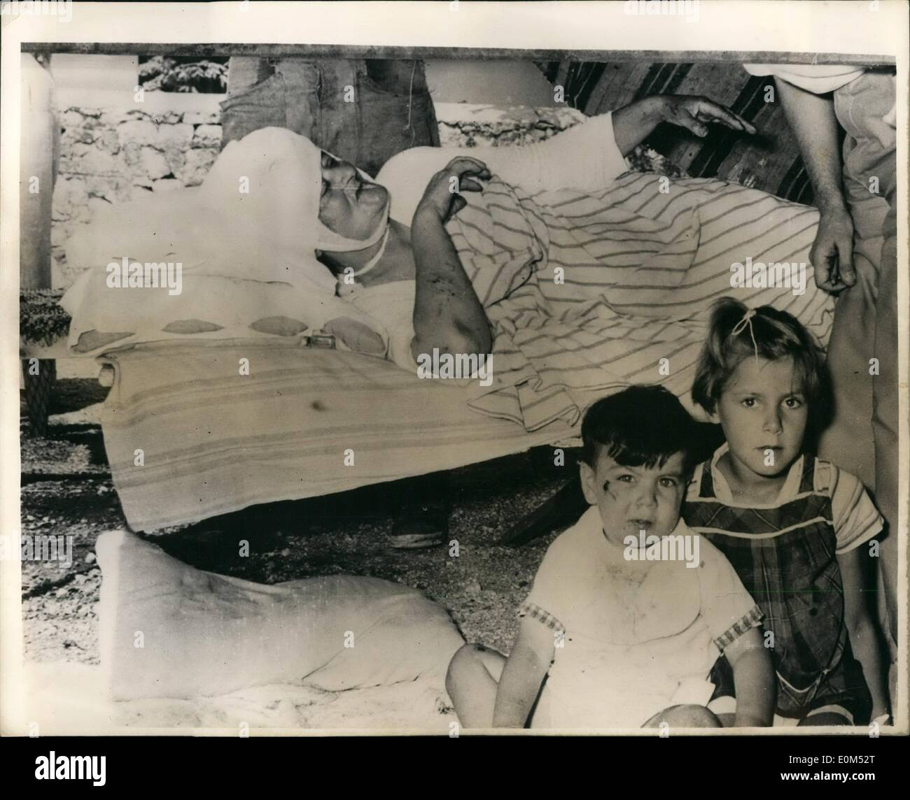 Aug. 08, 1953 - The Greek earthquake disaster.: Photo shows these two little Greek children sit beside their injured Stock Photo