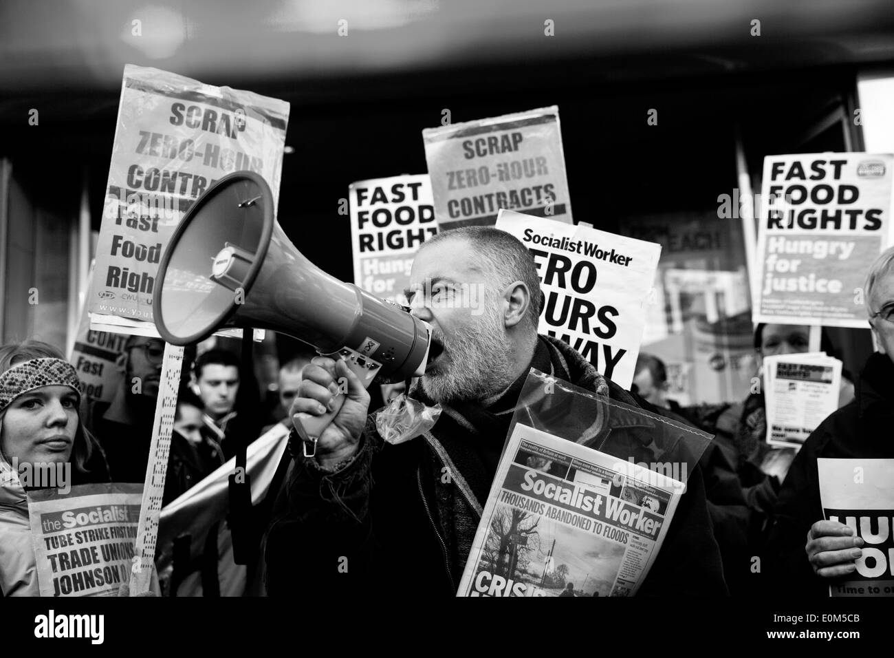 Fast food workers protest in London. - Stock Image