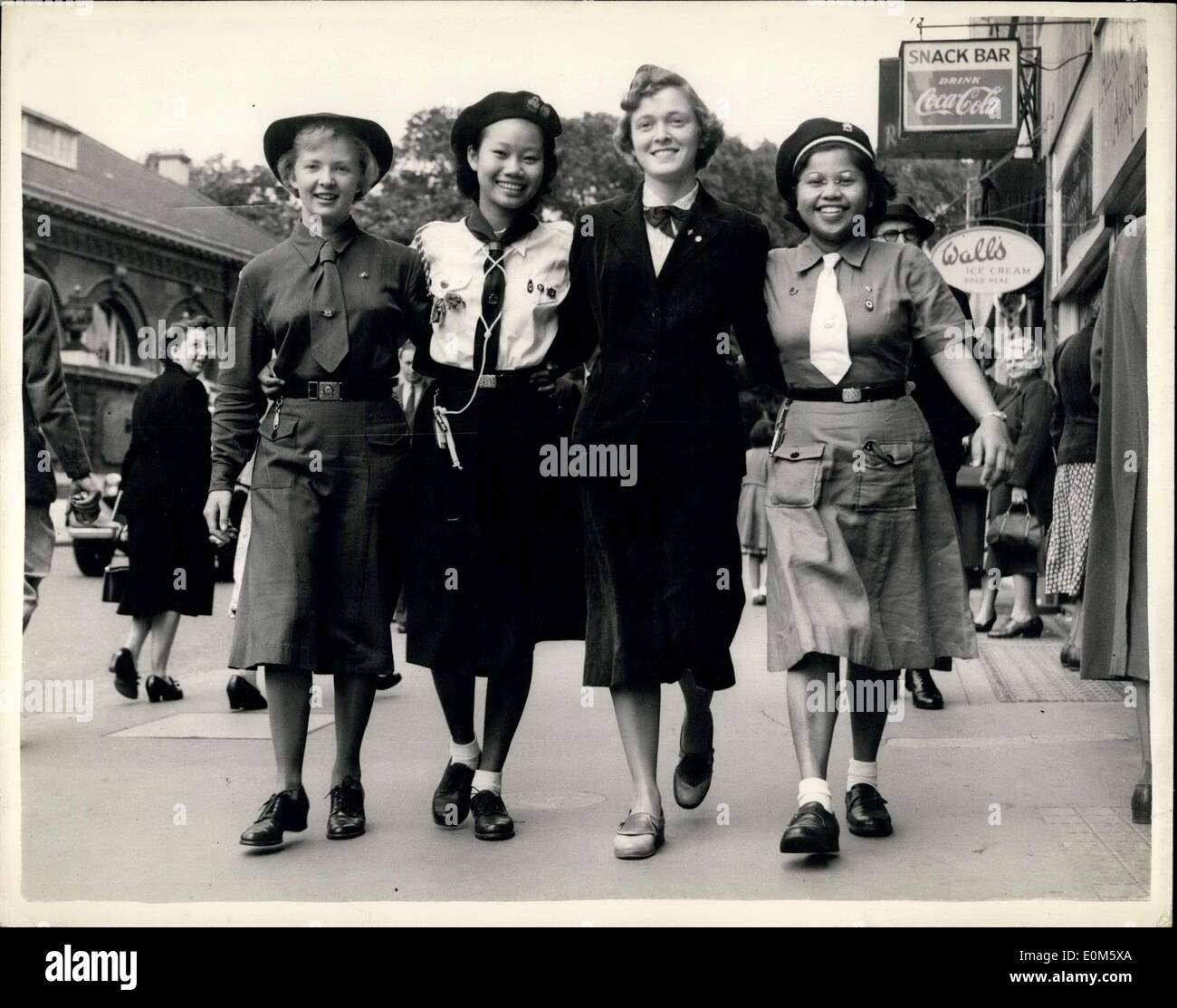 Jul. 20, 1953 - On way International Guide gathering. Canada; USA; and Singapore: Many International Girl Guides and Girl Scouts are in London - on route for the annual International gathering of Rangers and Senior Girl Scouts which is to be held at Abelboden. Switzerland during the next three weeks. Photo shows at the Girl Guides Association Buckingham Palace Road - this morning - Left to right: - Nora Collins (17) of Canada; Anna Young (19) of Singapore and Joyce Williams (17) of the U.S.A and Hasnah Ali Binte Ali (1) who comes from Malaya. - Stock Image