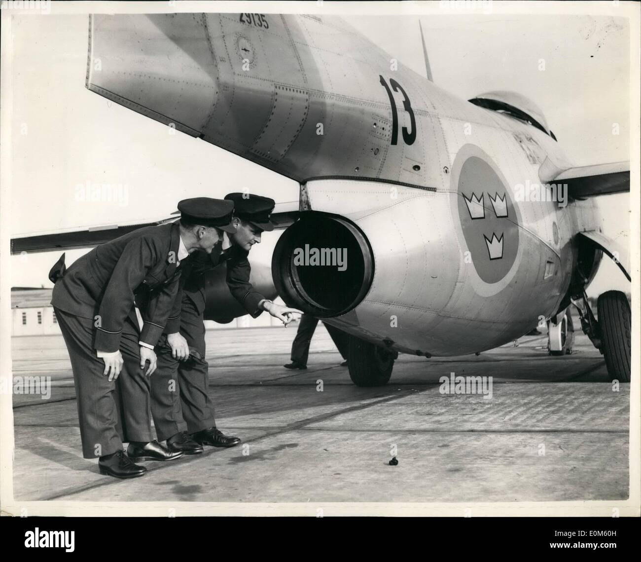 Oct. 10, 1953 - Royal Swedish Air Force Goodwill Visit To R.A.F.: A new swept-wing barrel-fuselage jet fighter will be seen over England during the next few days. It is the j.29 of the royal Swedish Air Force, which is faster than any of the Meteors with which the RAF fighter squadrons are equipped. Today, eight of the Swedish J 29s landed at R.A.F. Station, Waterbeach Cambridge, on a week's goodwill mission. Photo shows. Flight Officer Wirdhan (nearest camera) and Flying Officer Barnard, two British pilots, examining the jet pipe of the Swedish J.29, at Waterbeach today. - Stock Image