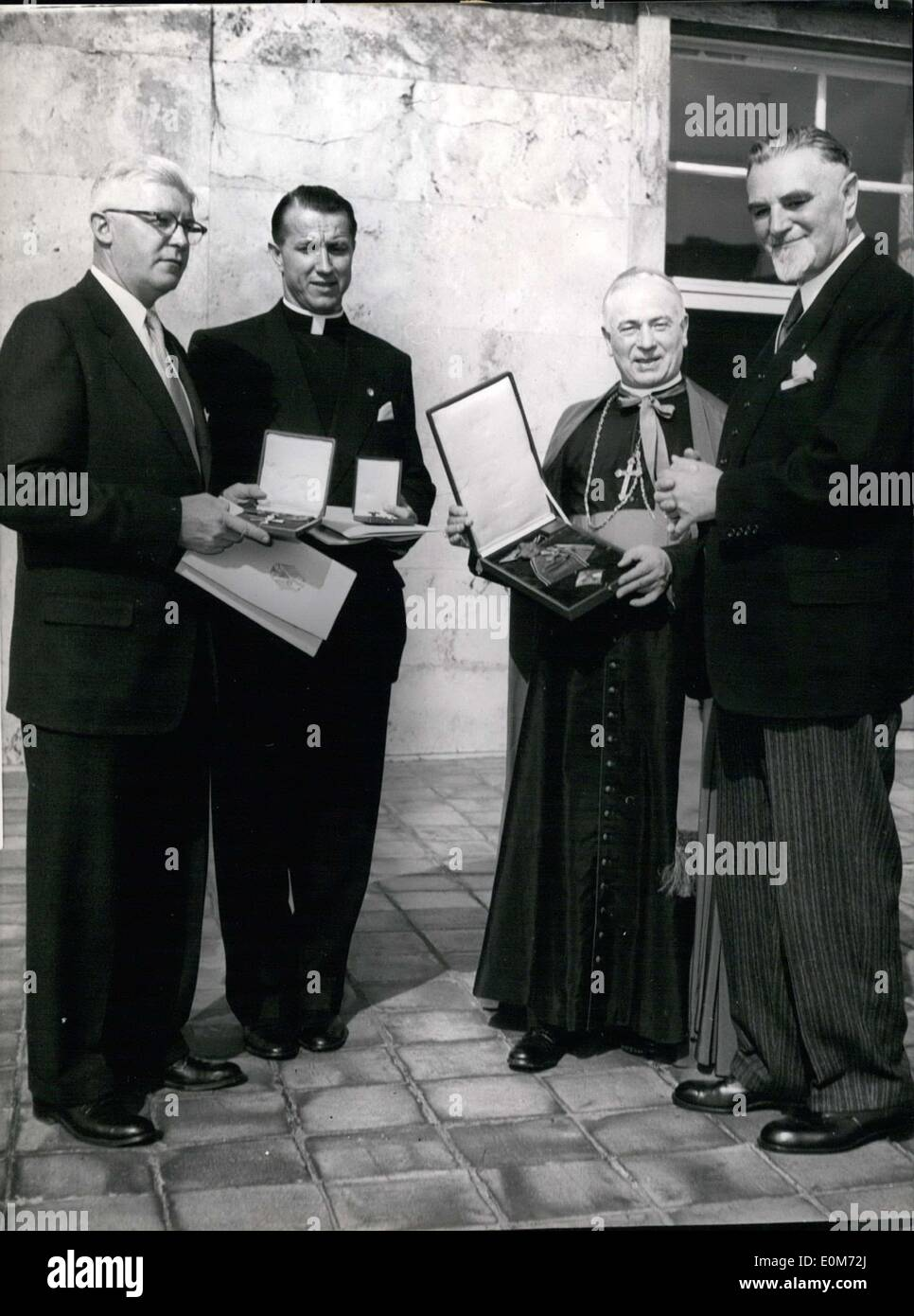 Sep. 26, 1953 - Bundesgovernment honours catholic priests from USA: Bundesminister Hans Lukaschek handels over by order of the Bundespresident the Bundesverdienst-crosses to three American Catholics, who did hart joined with a welfare-organisation for Germany. Photo shows (left) James J. Morris (european chief of the organisation to reduce war-cases), Alfred J. Schneider (director of this organisation), Arc-bishop Karl J. Alter, Cincinna ti, (Chairman of the curatorium of the organisation) - Stock Image