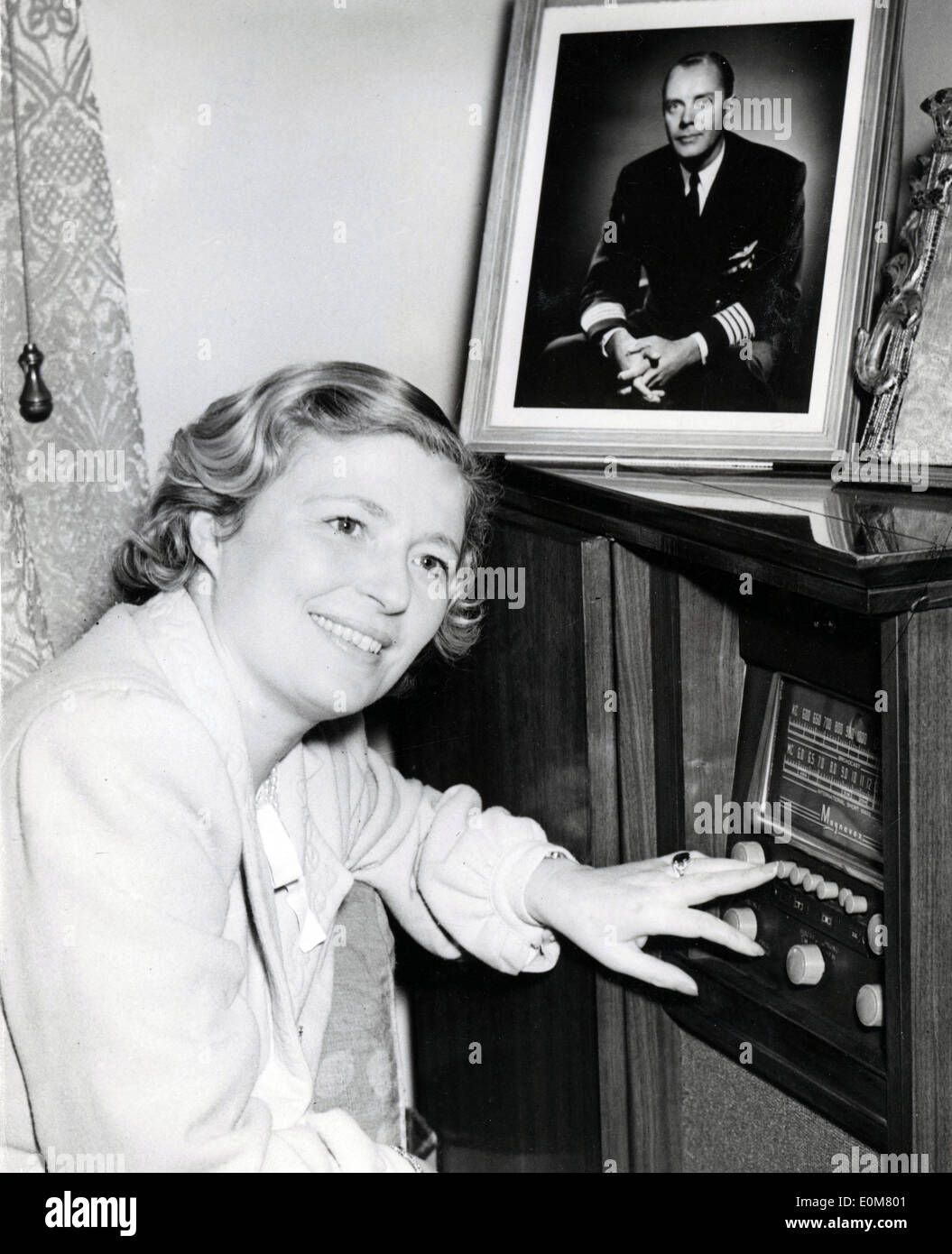 Nov. 24, 1953 - London, England, U.K. - Wife of Captain A.C. Loraine, MARY LORAINE still wearing her nightgown and housecoat listens to the radio, while police have sealed her bedroom to search for clues after a large robbery. - Stock Image