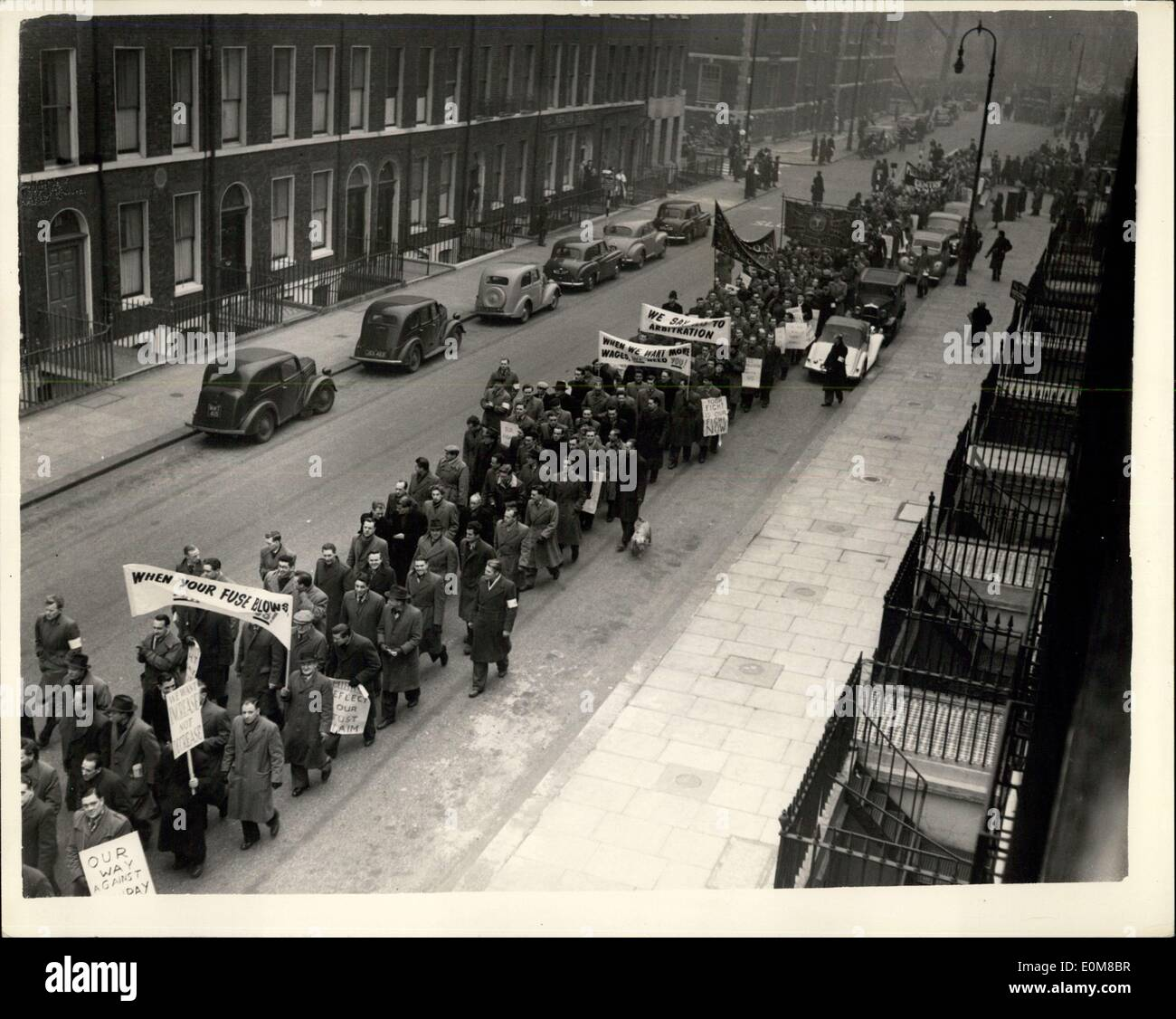 Jan. 28, 1954 - Strikers March In London: London electrical strikers marched today from Bloomsbury to the City to demonstrate in support of their demands for a wage increase. More than 7, 000 electricians have been on strike in London since Monday and will remain out until Sunday. Photo Shows General view showing as the strikers marched through Doughty-street, with their banners today. - Stock Image