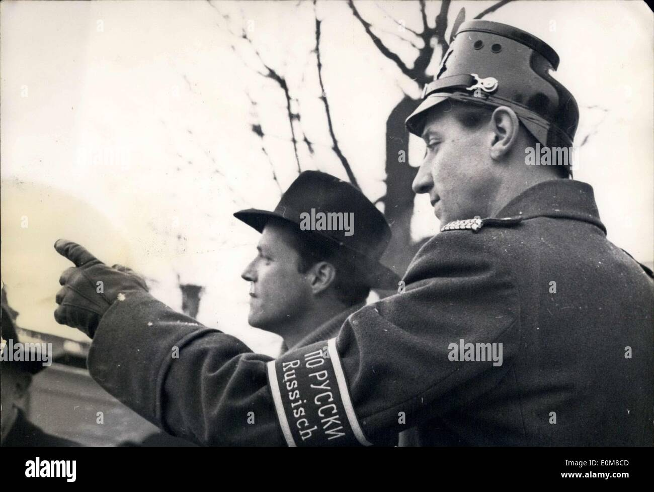 Jan. 31, 1954 - Berlin policemen have organized a translation service to help ease the burden on foreign journalists in the city for the major Berlin Conference of the four Allied Powers. This policemen translates Russian. - Stock Image