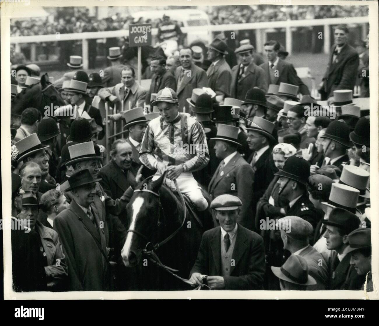 Feb. 02, 1954 - Derby - At Epsom. ''Never- Say Die'' Wins.. Picture Shows: General view showing the winner ''Never Say Die'' - entering the unsaddling enclosure - after winning the Derby at Epsom this afternoon. Lester Piggott is the Jockey. - Stock Image