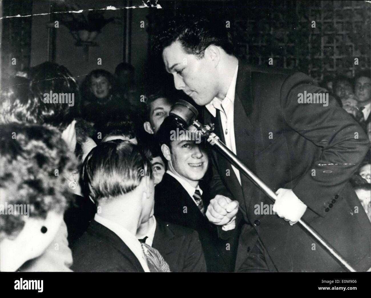 Feb. 02, 1954 - Teenagers At A Swing Session.: in British dance halls, where jazz sessions attract hundreds of teenagers and the floor is so crowded dancing becomes almost impossible, something like hysteria can develop. This picture was taken at the Brighton aquaria palais. Nearly 3,000 young people crowded the hall, many of them climbing on chairs and tables to glimpse their idols of song and hot music when band leader Ted Heath with singers Dickie Valentine and Lita Roza were performing - Stock Image