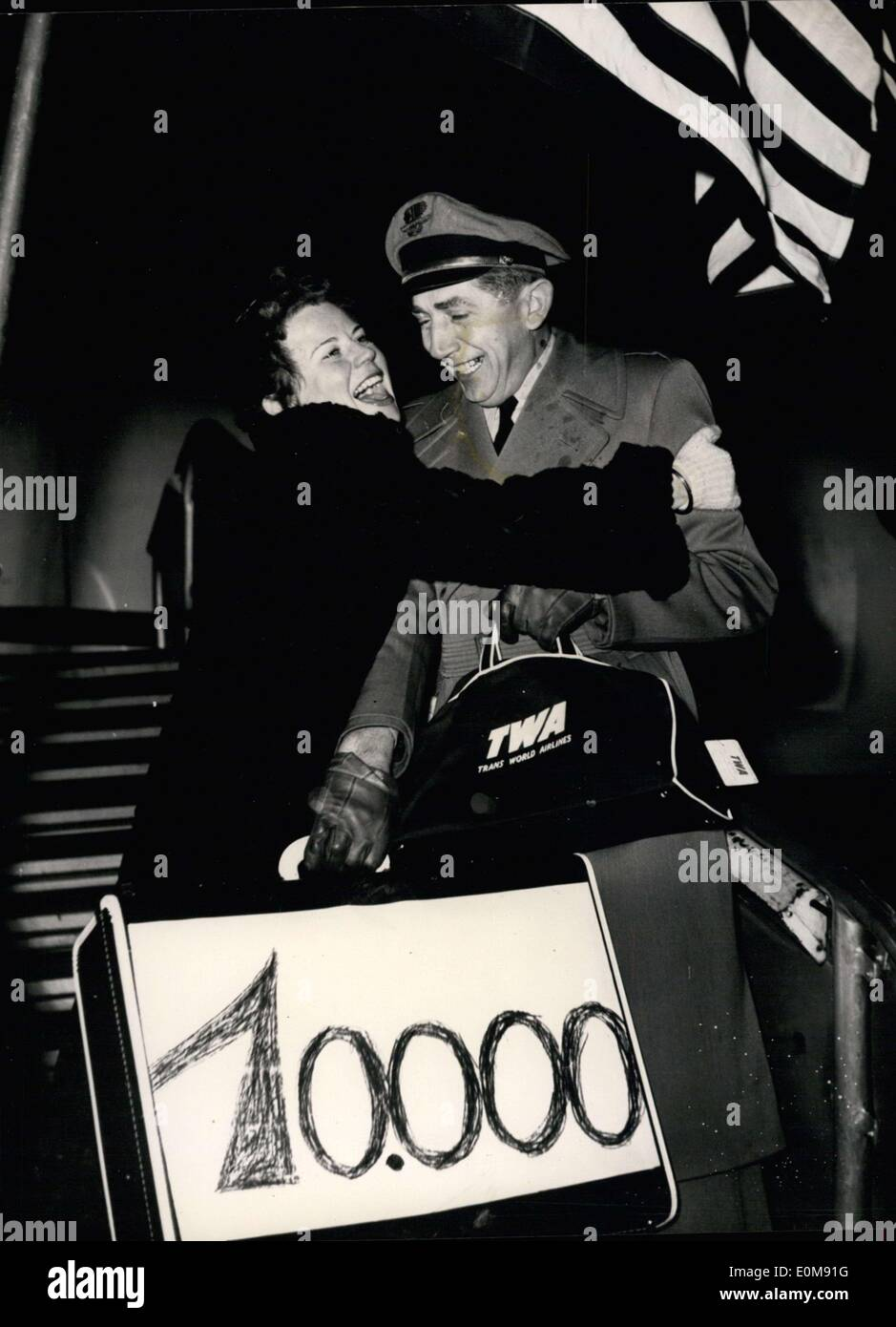 Feb. 03, 1954 - The German-American exchange program celebrates a threefold anniversary today. Departing from the Rhein-Main airport, thirty two year old translator Hilda Wiehers from Essen was the 10,000th German to leave her home in order to spend a three-month study trip in the United States. It is the 500th flight to bring a study group to the USA, with the first being five years ago today. Pictured: Radiant with joy, Ms. Wiehers flings her arms around flight captain Pretsch's neck when he greets her before boarding the plane. - Stock Image